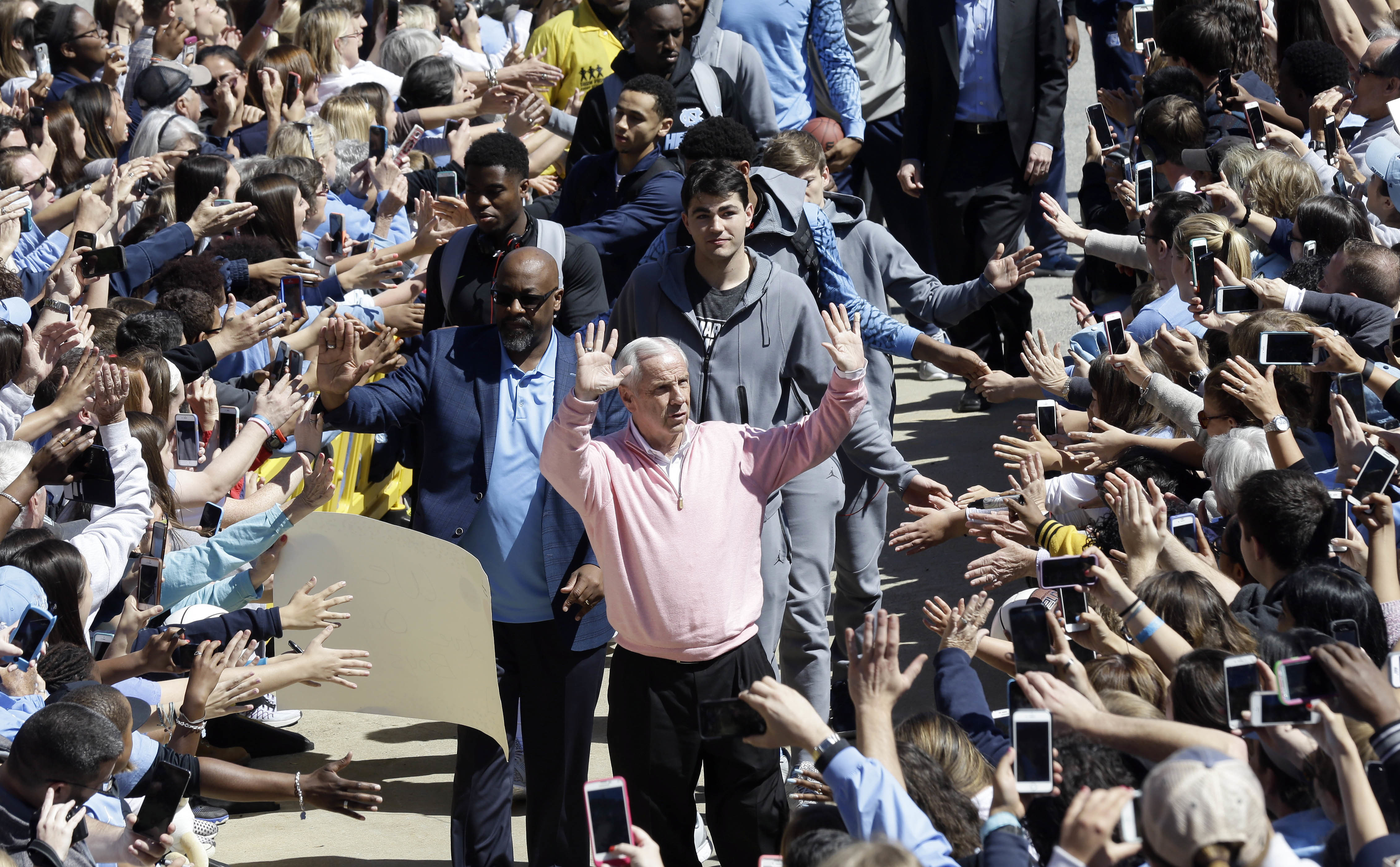 Fans welcome home North Carolina coach Roy Williams and his team in Chapel Hill, N.C., Tuesday, April 5, 2016, following the team's 77-74 loss to Villanova in the NCAA college basketball Final Four championship game Monday night in Houston. (AP Photo/Gerr