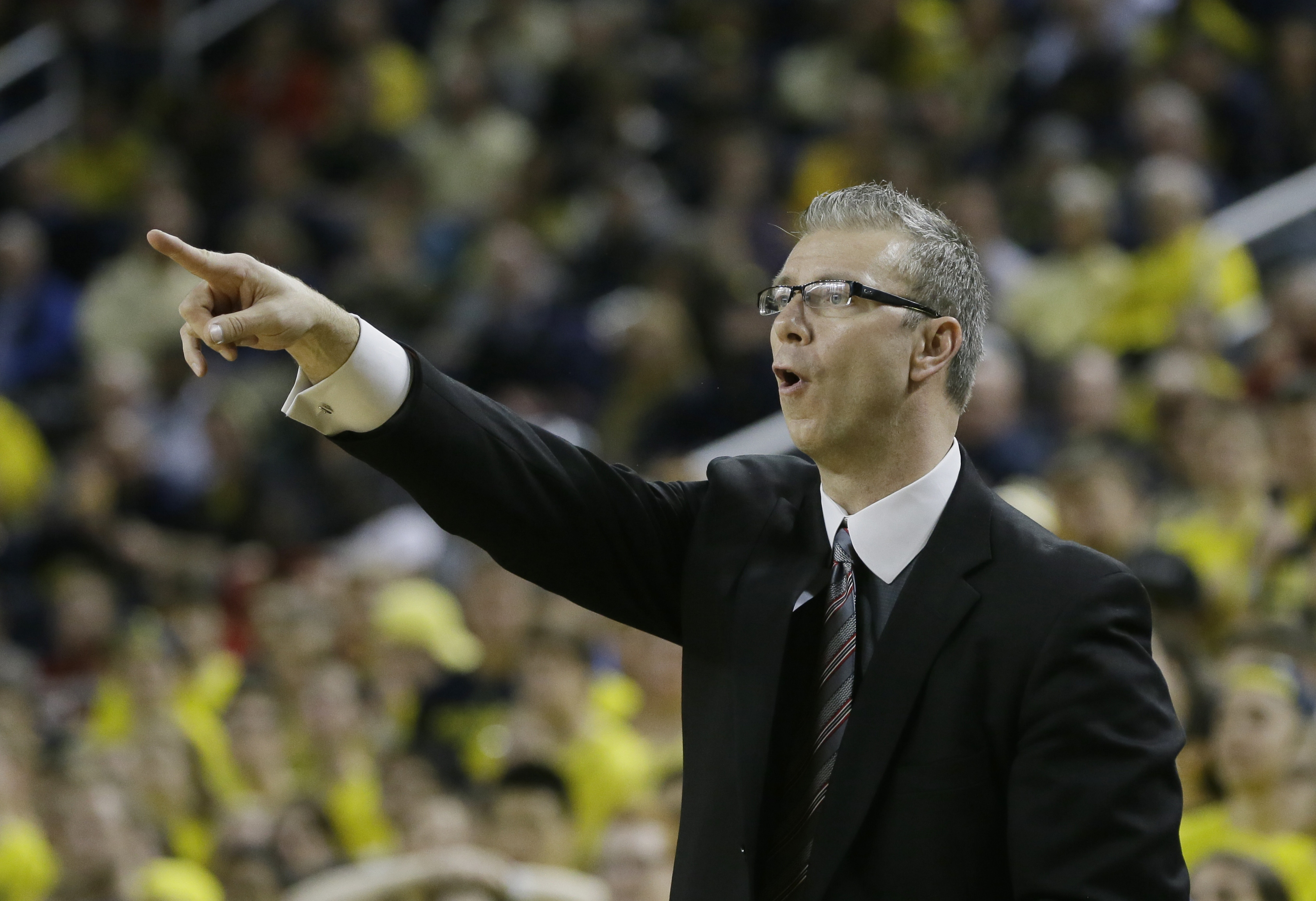 Ohio State assistant coach Jeff Boals directs from the sidelines during the second half of an NCAA college basketball game against Michigan, Sunday, Feb. 22, 2015 in Ann Arbor, Mich. Michigan defeated Ohio State 64-57. (AP Photo/Carlos Osorio)