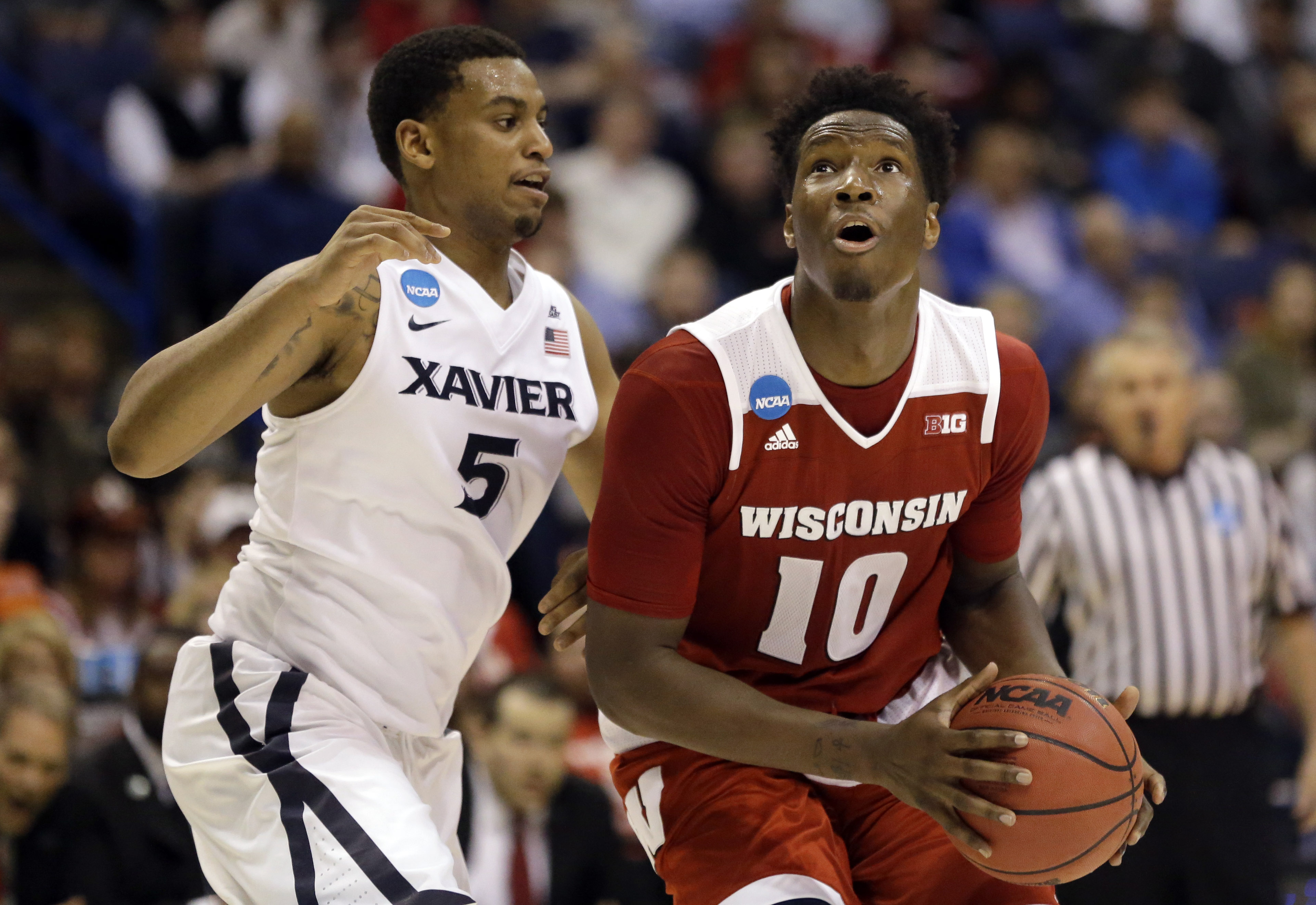 Wisconsin's Nigel Hayes looks to the basket as Xavier's Trevon Bluiett, left, defends during the second half in a second-round men's college basketball game in the NCAA Tournament, Sunday, March 20, 2016, in St. Louis. Wisconsin won 66-63. (AP Photo/Jeff