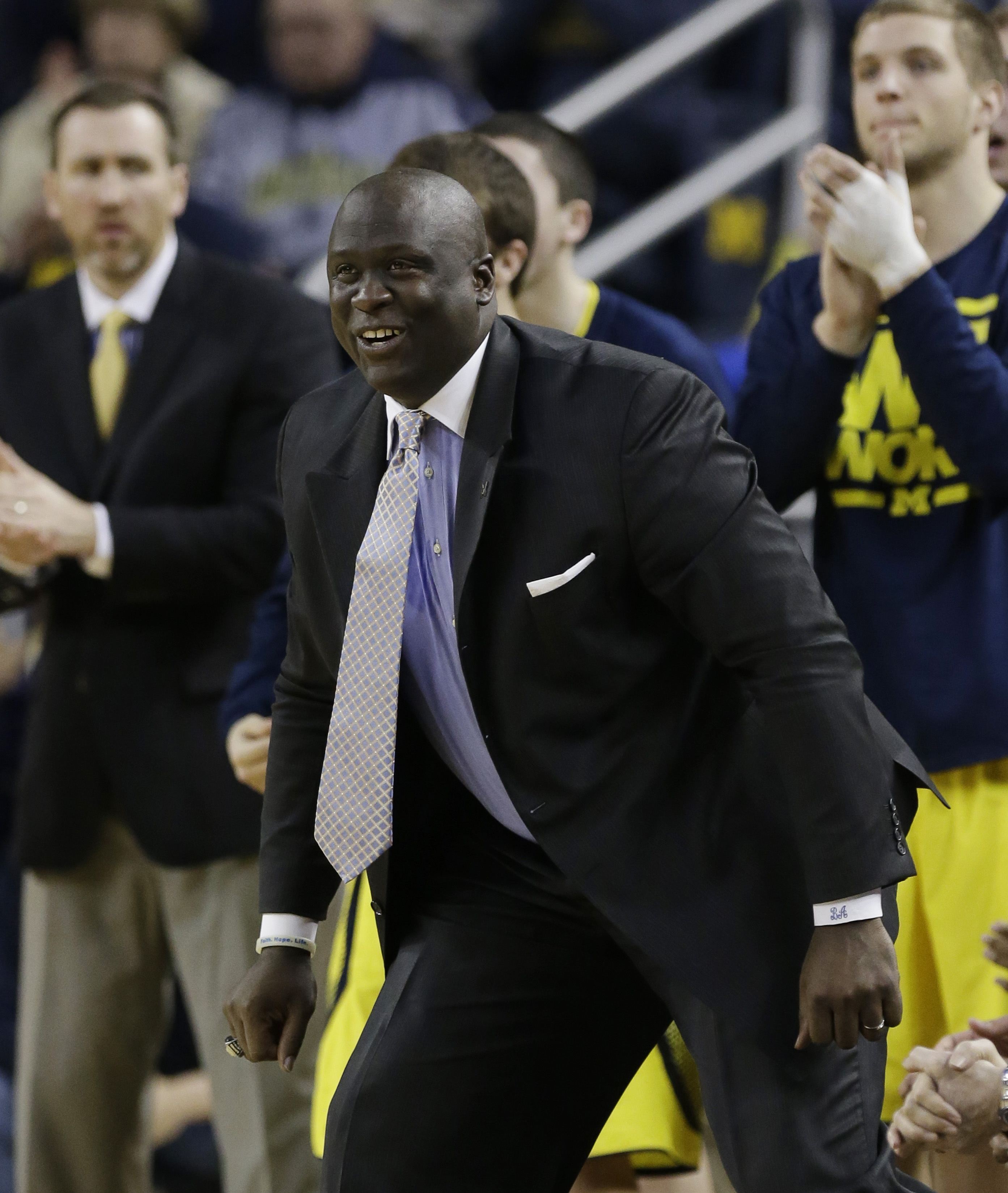 Michigan assistant coach Bacari Alexander is seen on the sidelines during the second half of an NCAA college basketball game against Wisconsin in Ann Arbor, Mich., Sunday, Feb. 16, 2014. (AP Photo/Carlos Osorio)