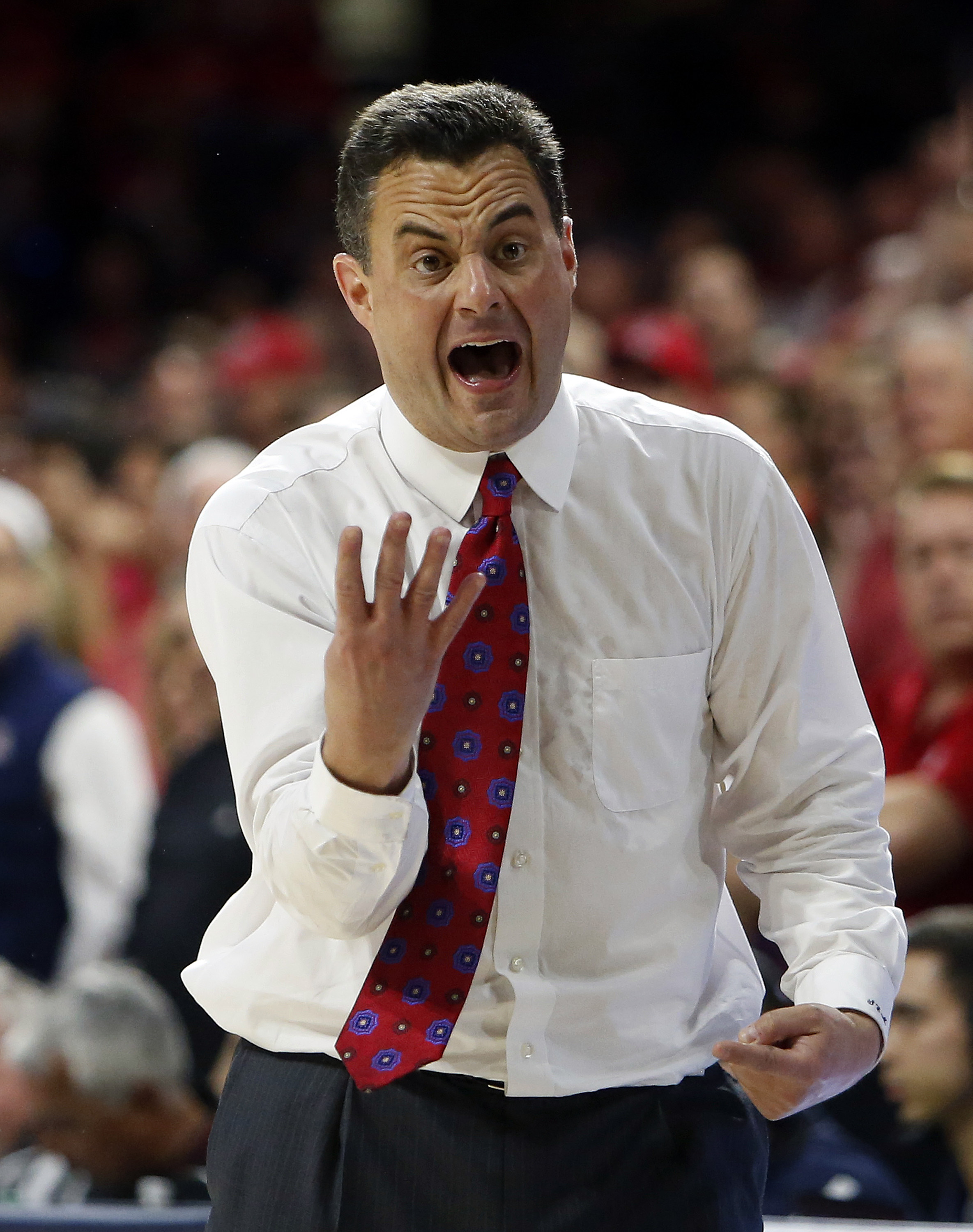 Arizona head coach Sean Miller reacts to a foul call during the second half of an NCAA college basketball game against California, Thursday, March 3, 2016, in Tucson, Ariz. (AP Photo/Rick Scuteri)