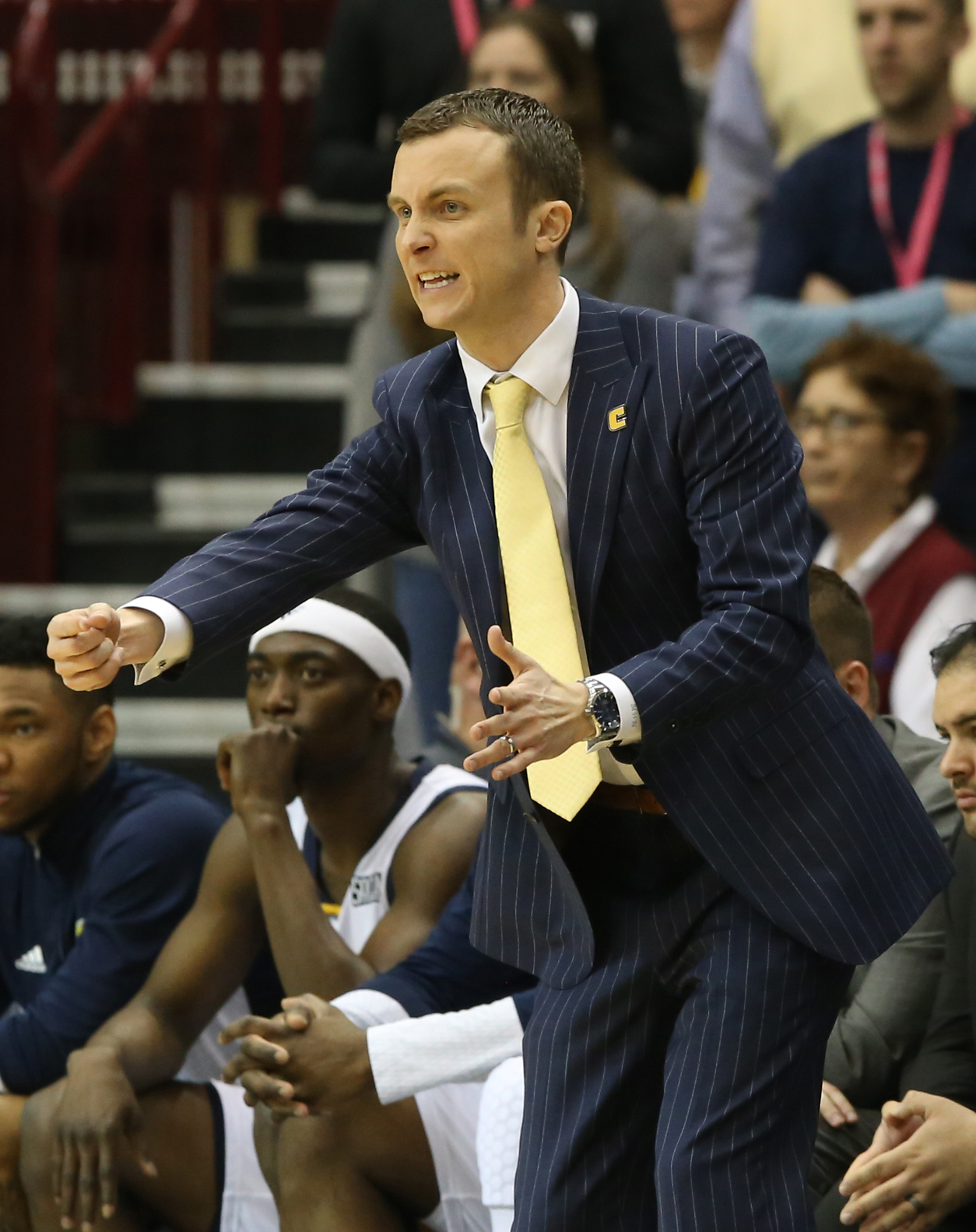 FILE - In this March 7, 2016, file photo, Chattanooga head coach Matt McCall yells out a play during the first half of the championship game of the NCAA men's Southern Conference basketball tournament in Asheville, N.C. Texas hired Shaka Smart away from V