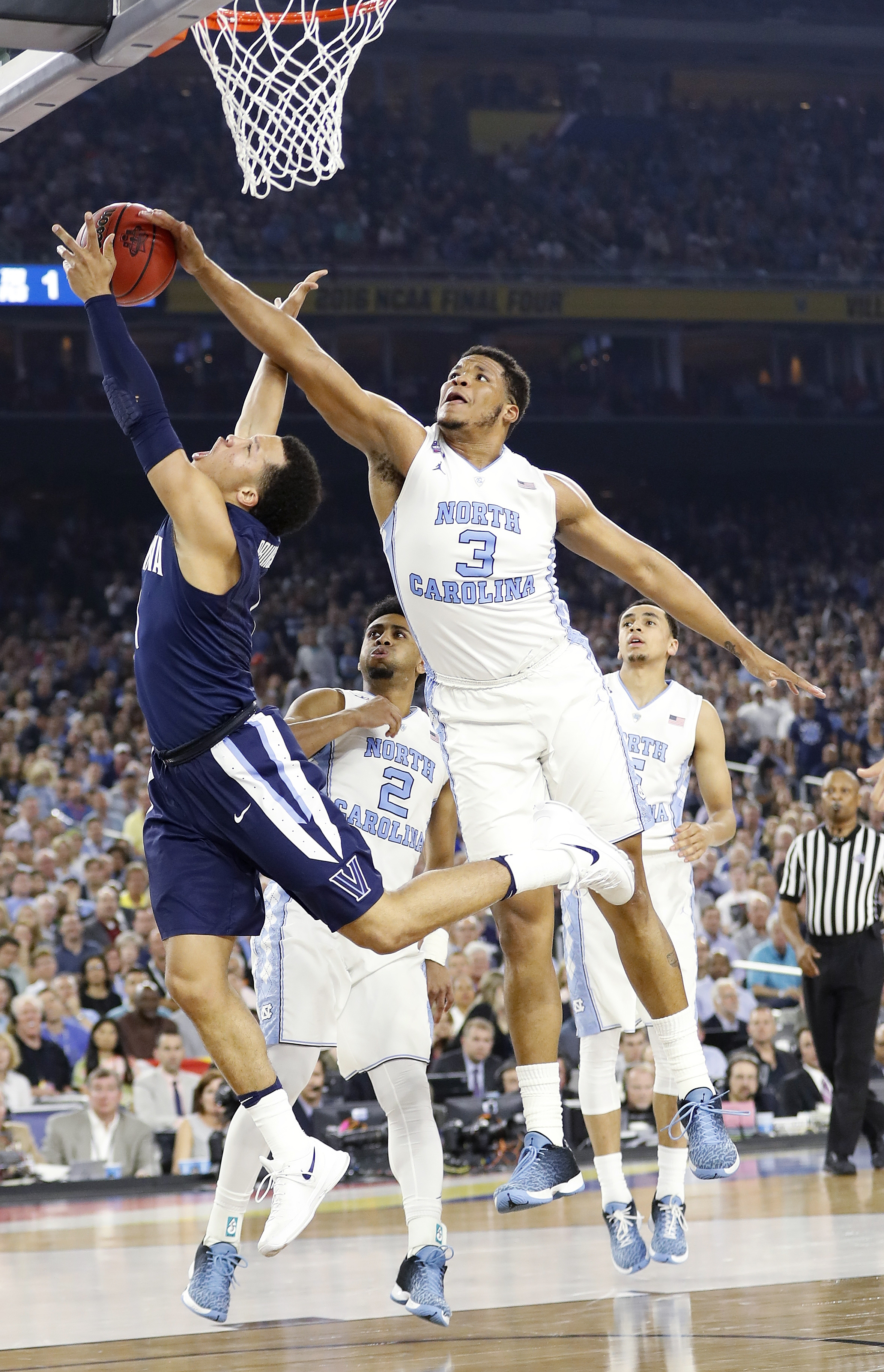 Villanova guard Jalen Brunson (1) has his shot defended by North Carolina forward Kennedy Meeks (3) during the second half of the NCAA Final Four tournament college basketball championship game Monday, April 4, 2016, in Houston. (AP Photo/Eric Gay)