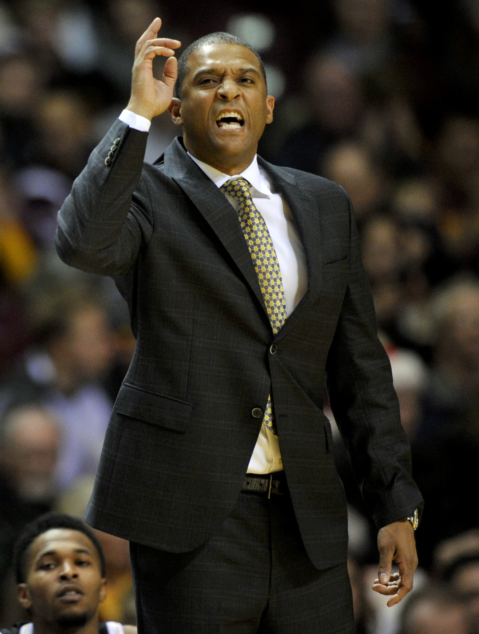 Milwaukee coach Rob Jeter reacts to a play during the second half of his team's NCAA college basketball game against Minnesota on Wednesday, Dec. 23, 2015, in Minneapolis. Milwaukee won 74-65. (AP Photo/Hannah Foslien)