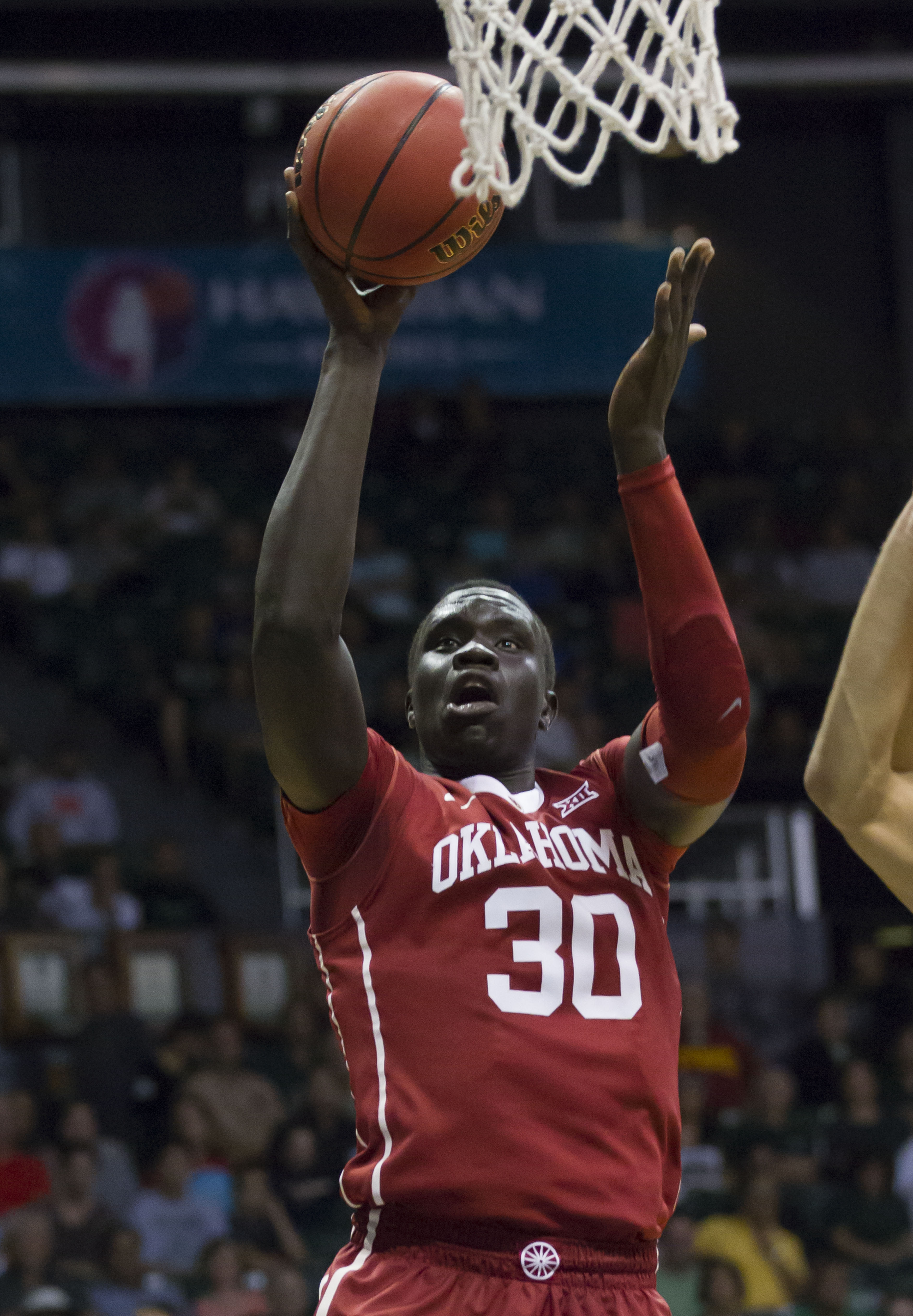Oklahoma center Akolda Manyang (30) shoots a jump shot while playing against Hawaii in the first half of an NCAA college basketball game at the Diamond Head Classic, Wednesday, Dec. 23, 2015, in Honolulu. (AP Photo/Eugene Tanner)