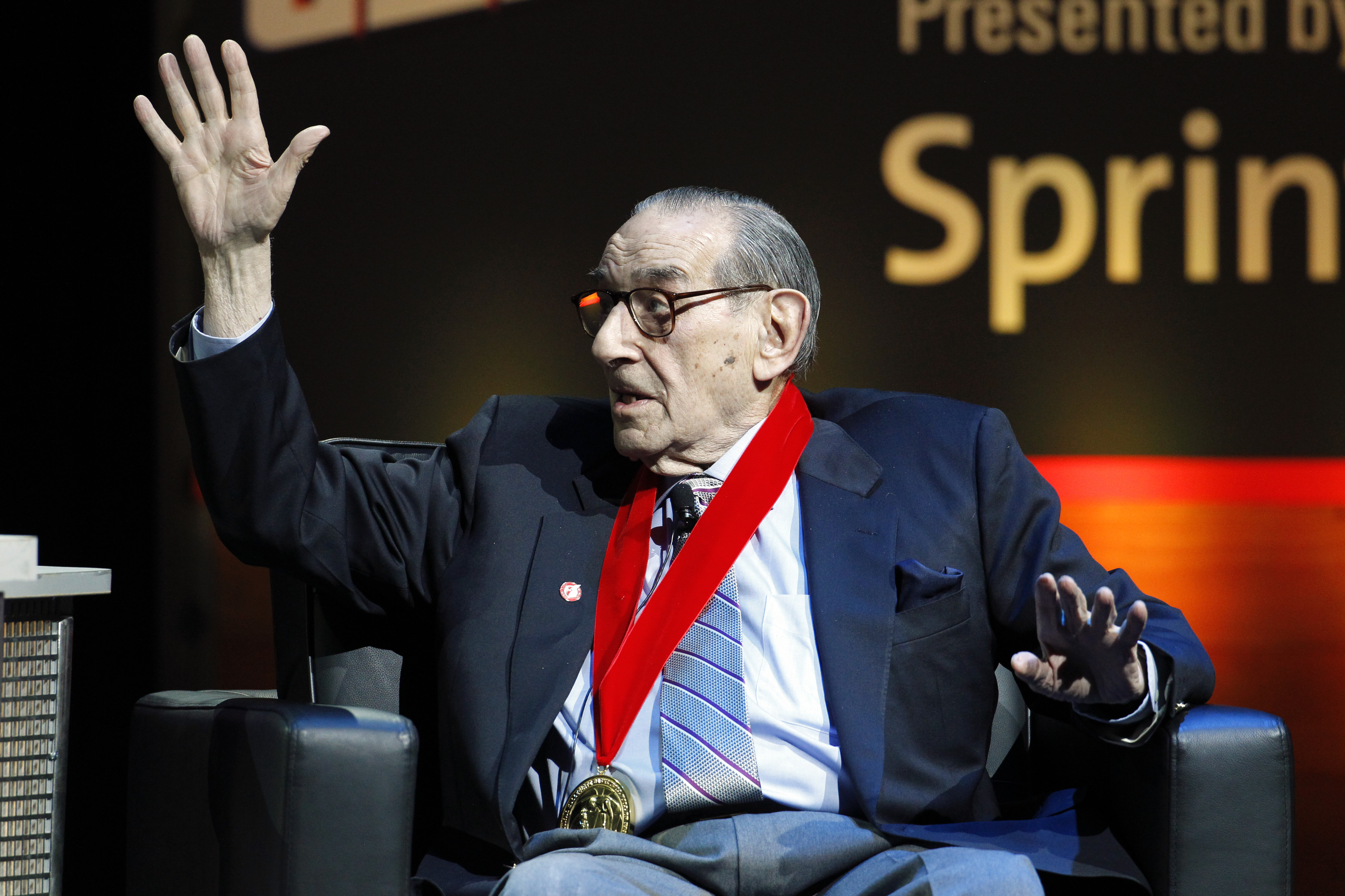 Five-Star Basketball Camp founder Howard Garfinkel talks about some of the star players he worked with during a National Collegiate Basketball Hall of Fame induction event, Sunday, Nov. 23, 2014, in Kansas City, Mo. (AP Photo/Colin E. Braley)