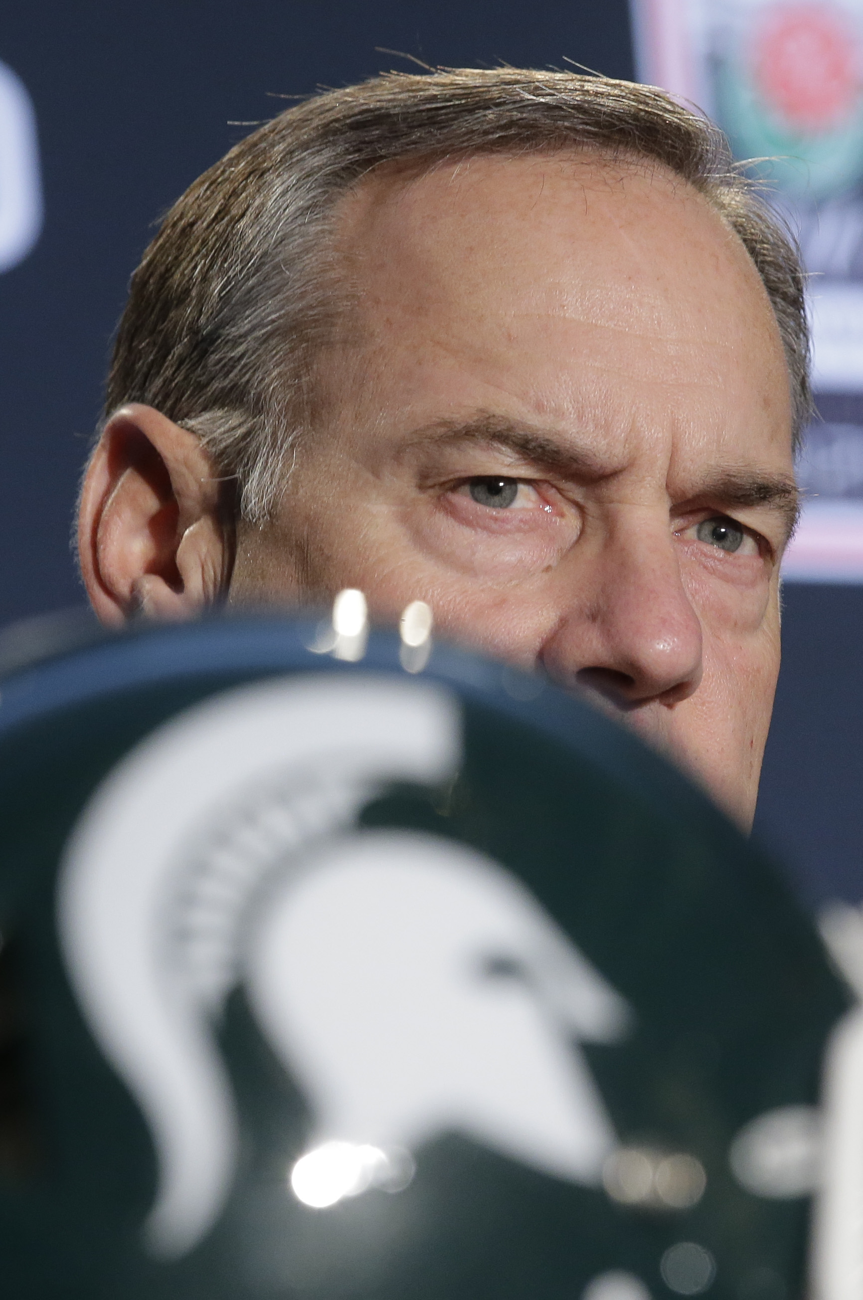 FILE- In this Dec. 30, 2014 file photo, Michigan State head coach Mark Dantonio takes questions during a news conference in Los Angeles before facing Stanford in the 100th Rose Bowl NCAA college football game. The pundits are talking up the Big Ten league