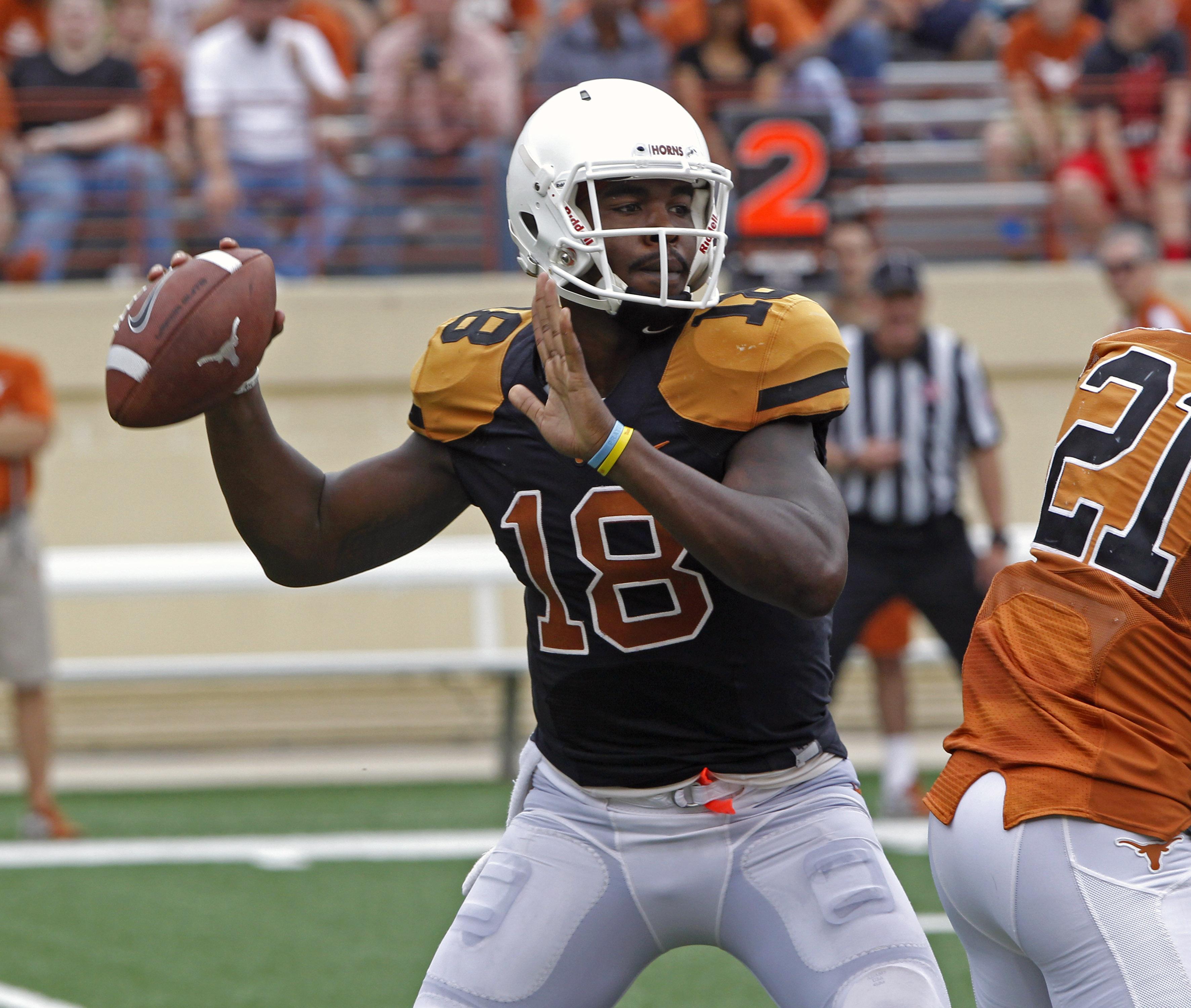 Texas quarterback Tyrone Swoopes (18) looks to throw during the first quarter of Texas' Orange and White spring NCAA college football game, Saturday, April 18, 2015, in Austin, Texas. (AP Photo/Michael Thomas)