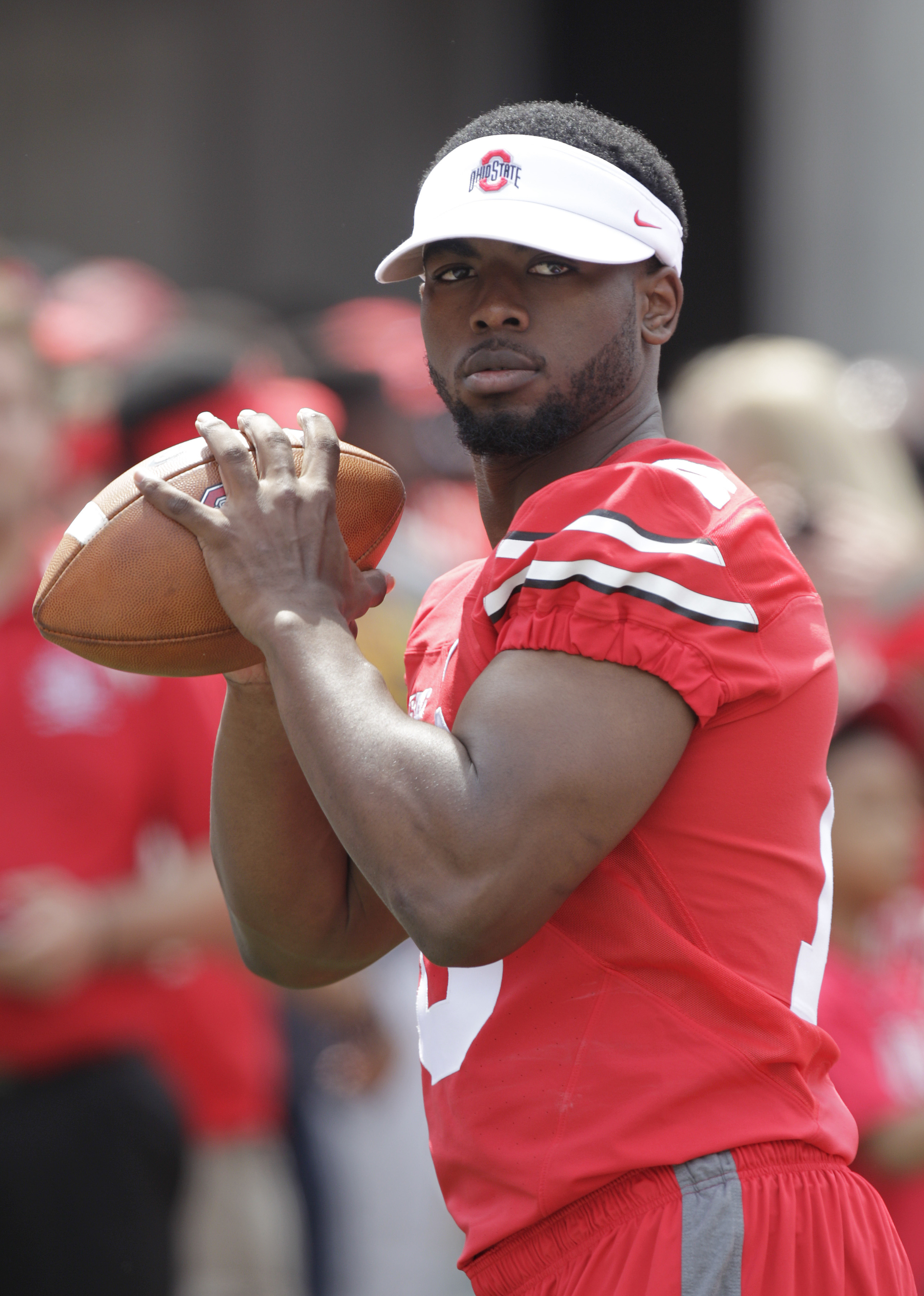 Ohio State quarterback J.T. Barrett warms up before the start of Ohio State's NCAA college football Spring game Saturday, April 18, 2015, in Columbus, Ohio. (AP Photo/Jay LaPrete)