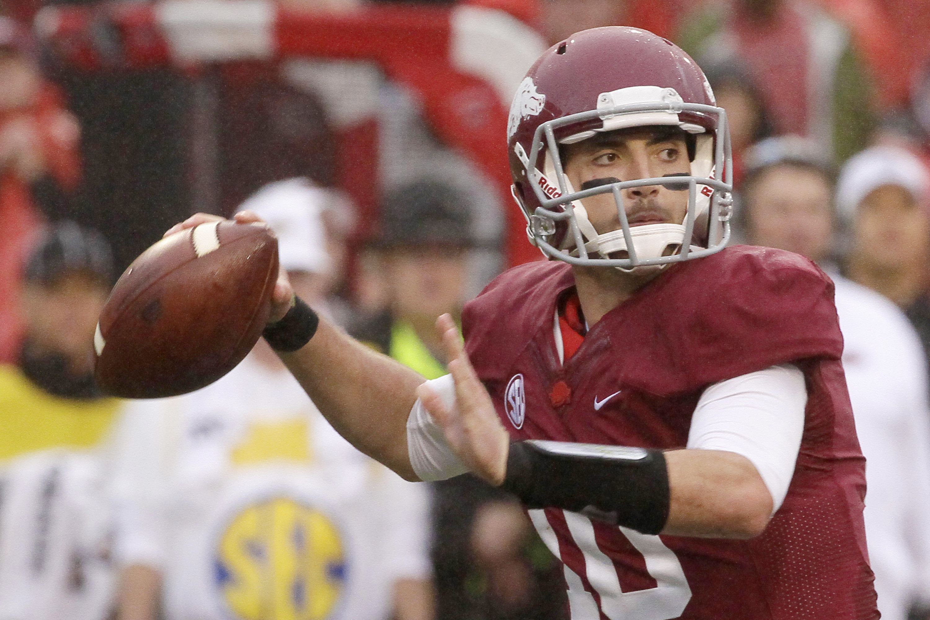 FILE - In this Oct. 11, 2014, file phot, Arkansas quarterback Brandon Allen passes in the first half of an NCAA college football game against Alabama in Fayetteville, Ark. The resurgent Razorbacks have enjoyed their relatively calm spring this year, which