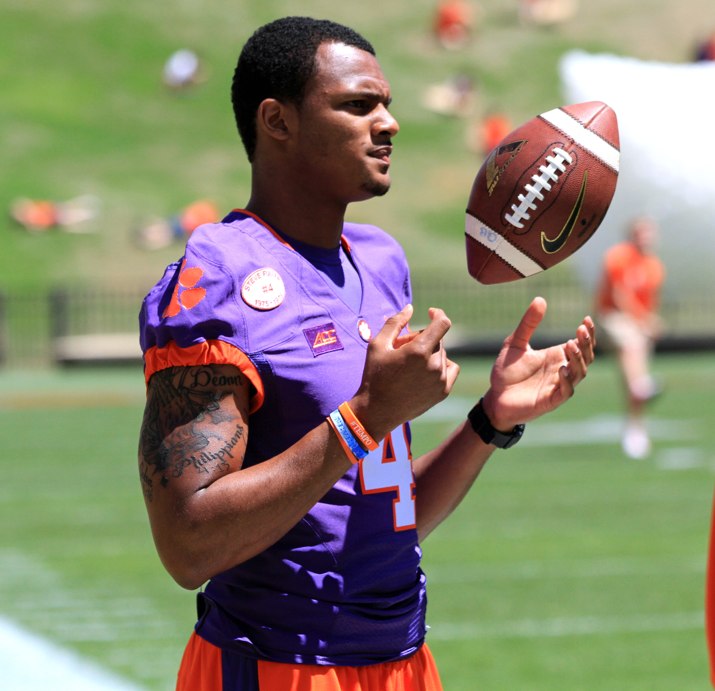 FILE - In this April 11, 2015, file photo, quarterback Deshaun Watson tosses a ball before Clemson's  NCAA college football spring game at Memorial Stadium in Clemson, S.C. Deshaun Watson was the most talked about player this spring without ever taking a