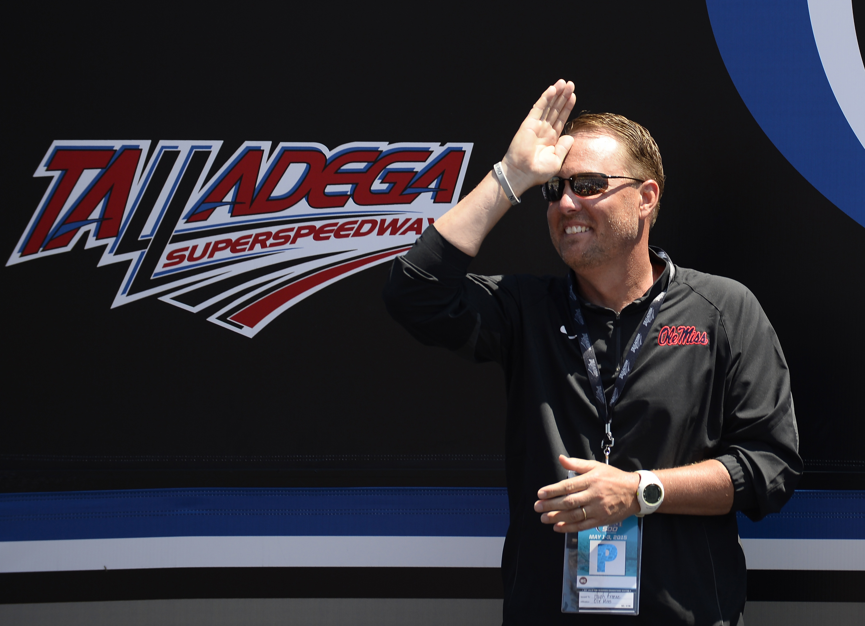 Honorary pace car driver and Mississippi head football coach Hugh Freeze gestures during introductions for the Talladega 500 NASCAR Sprint Cup Series auto race at Talladega Superspeedway, Sunday, May 3, 2015, in Talladega, Ala. (AP Photo/David Tulis)