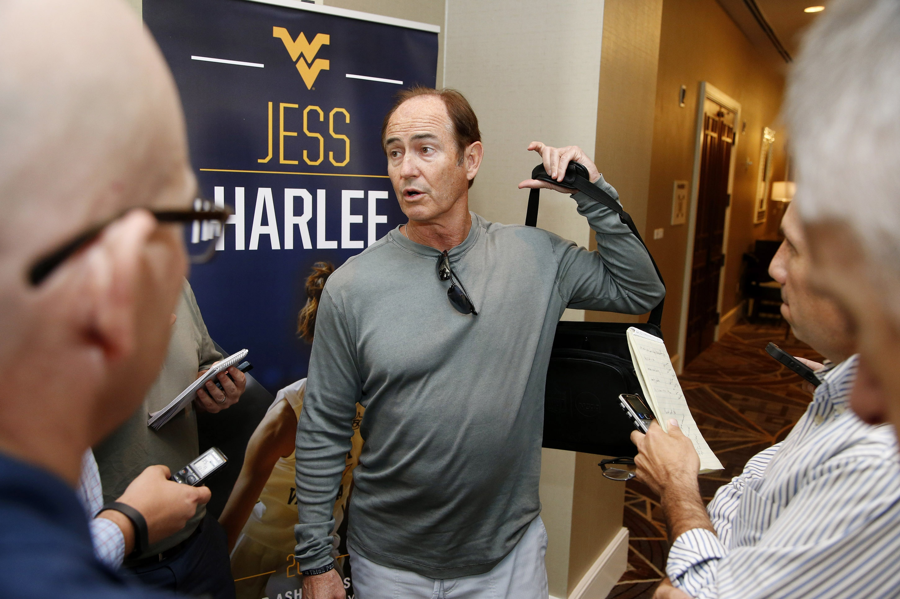 Baylor head football coach Art Briles talks with reporters before joining other football coaches at the annual Big 12 Conference meetings Tuesday, May 5, 2015, in Phoenix. (AP Photo/Ross D. Franklin)