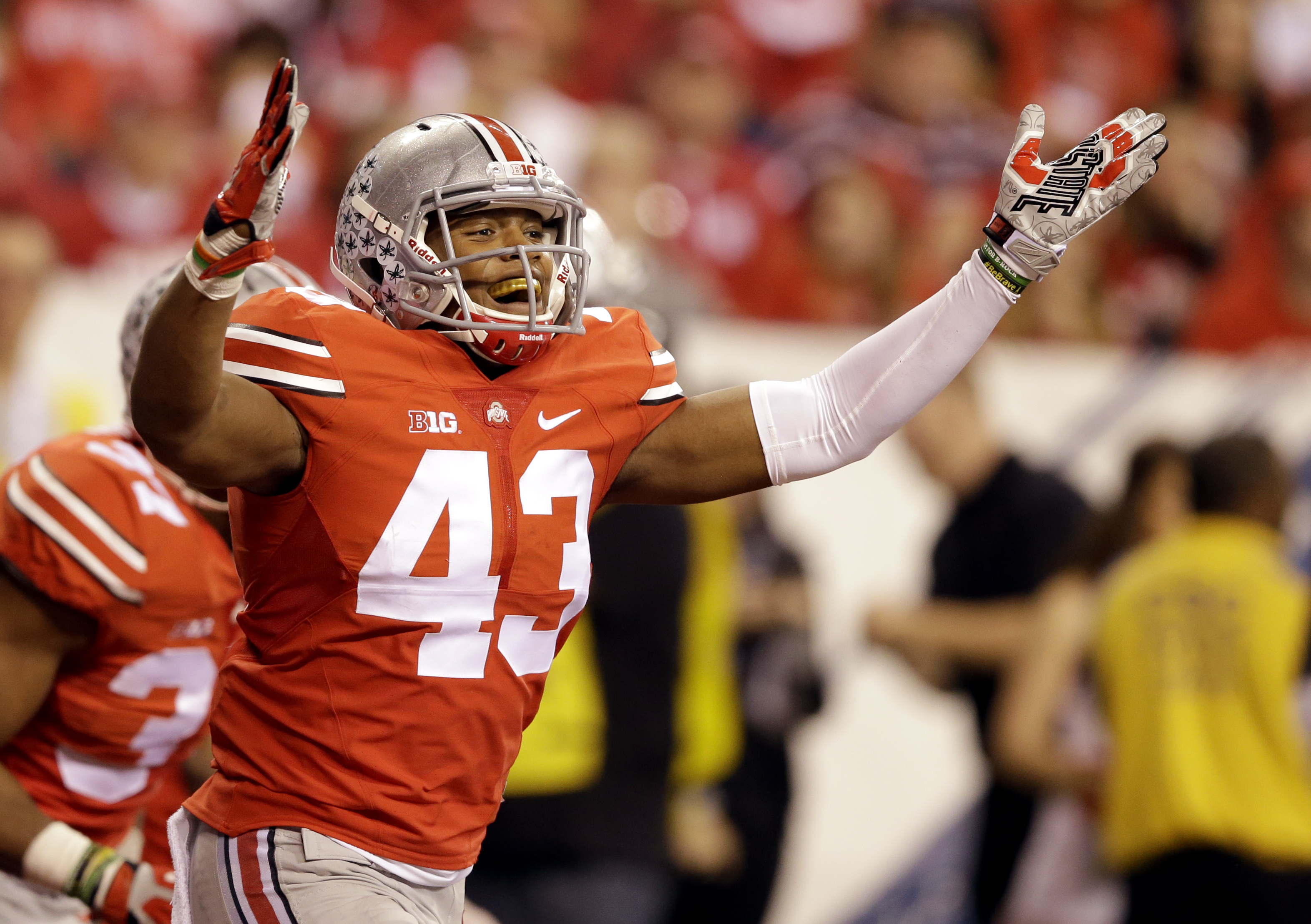 FILE - In this Dec. 6, 2014 file photo, Ohio State linebacker Darron Lee celebrates after teammate Joey Bosa picked up a fumble by Wisconsin running back Melvin Gordon and ran it back for a touchdown during the first half of the Big Ten Conference champio
