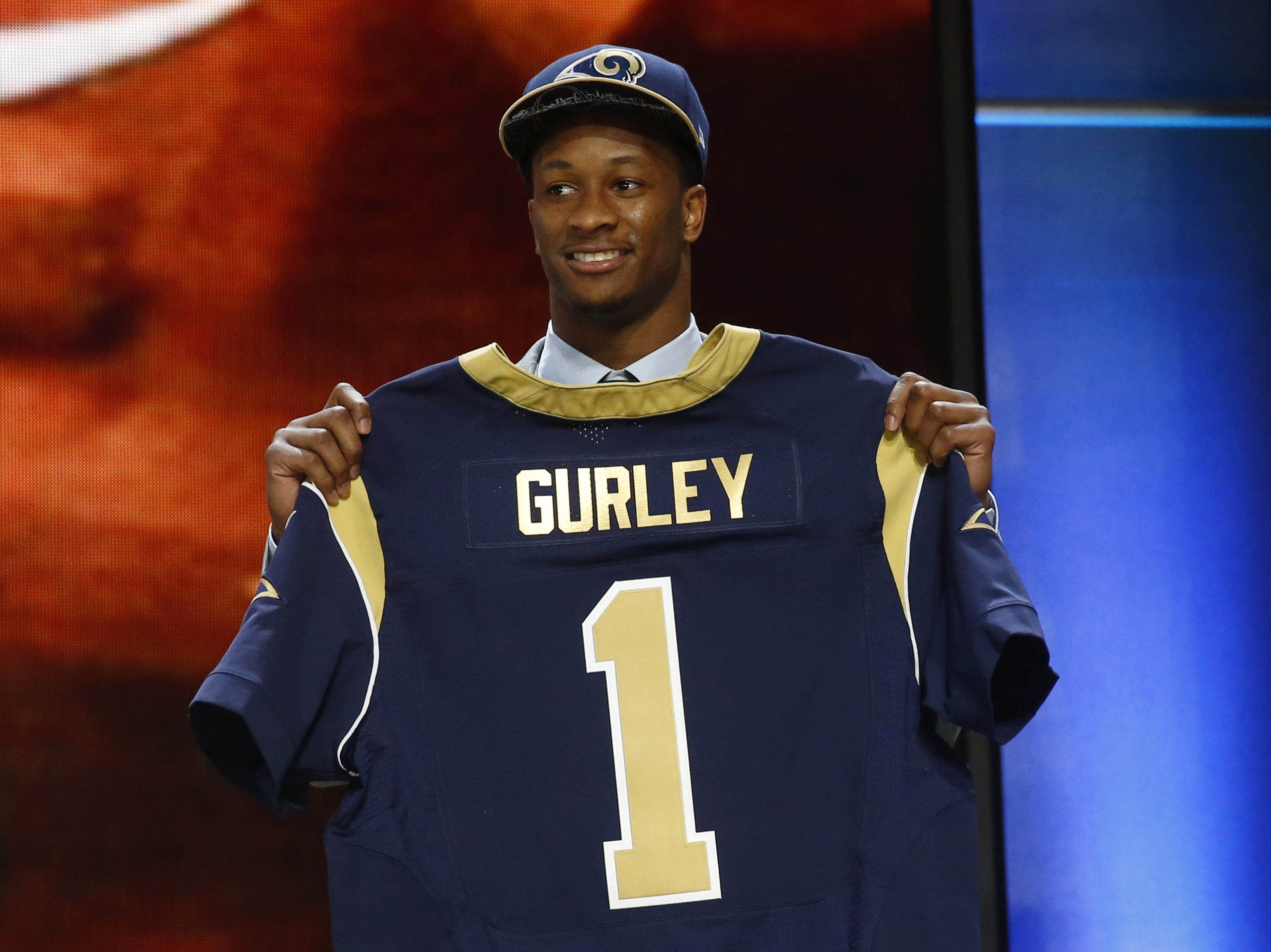 FILE - In this Thursday, April 30, 2015 file photo, Georgia running back Todd Gurley poses for photos after being selected by the St. Louis Rams as the 10th pick in the first round of the 2015 NFL Draft in Chicago. Georgia Gov. Nathan Deal has signed into