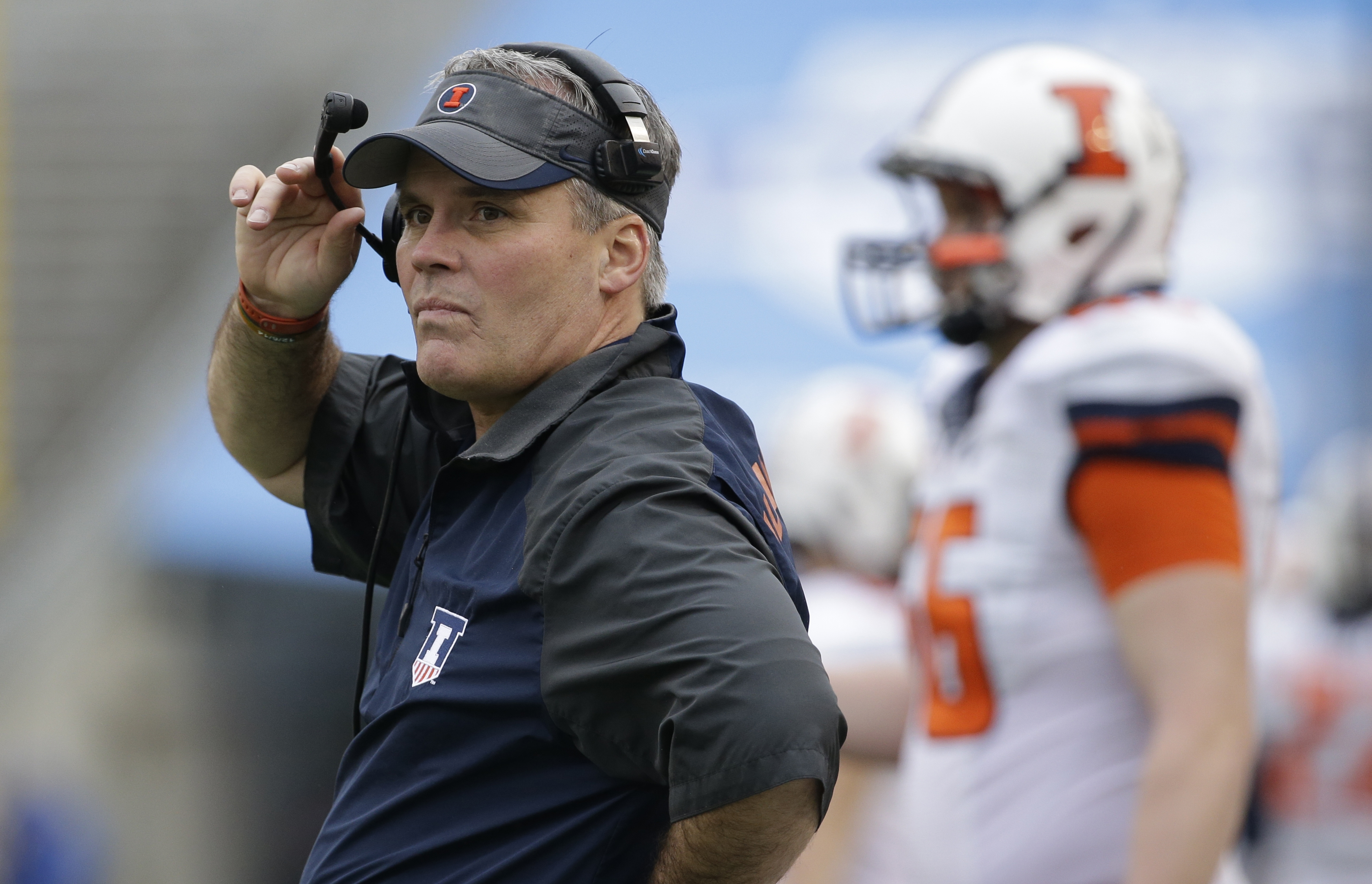 FILE - In this Dec. 26, 2014, file photo, Illinois head coach Tim Beckman watches from the sidelines during the first half of the Heart of Dallas Bowl NCAA college football game against Louisiana Tech in Dallas. A national advocacy group for college footb