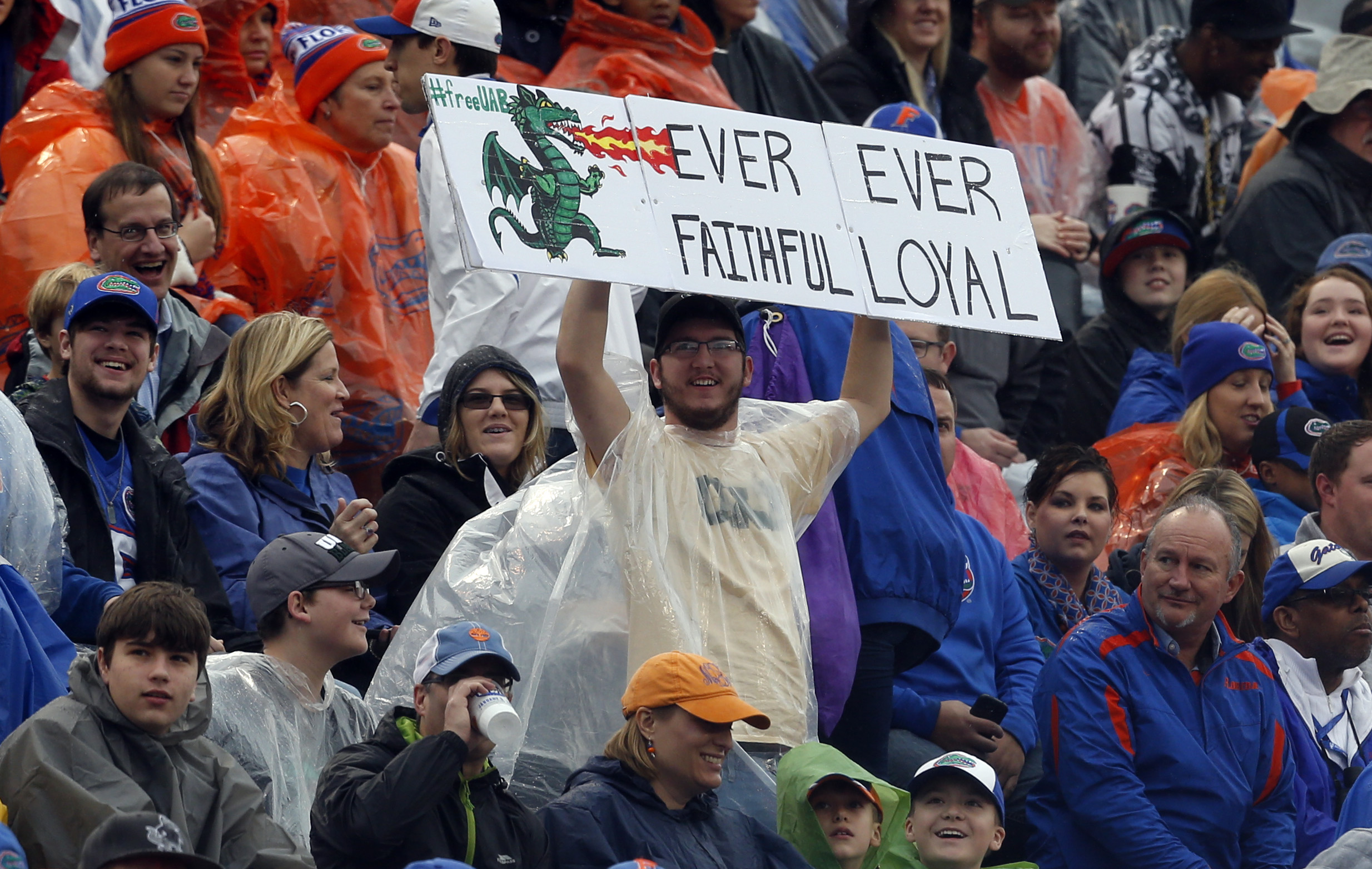 File - In this Saturday, Jan. 3, 2015, file photo, an UAB fan declares his loyalty for the terminated football program at the Birmingham Bowl NCAA college football game between Florida and East Carolina, in Birmingham, Ala. UAB president Ray Watts is brin