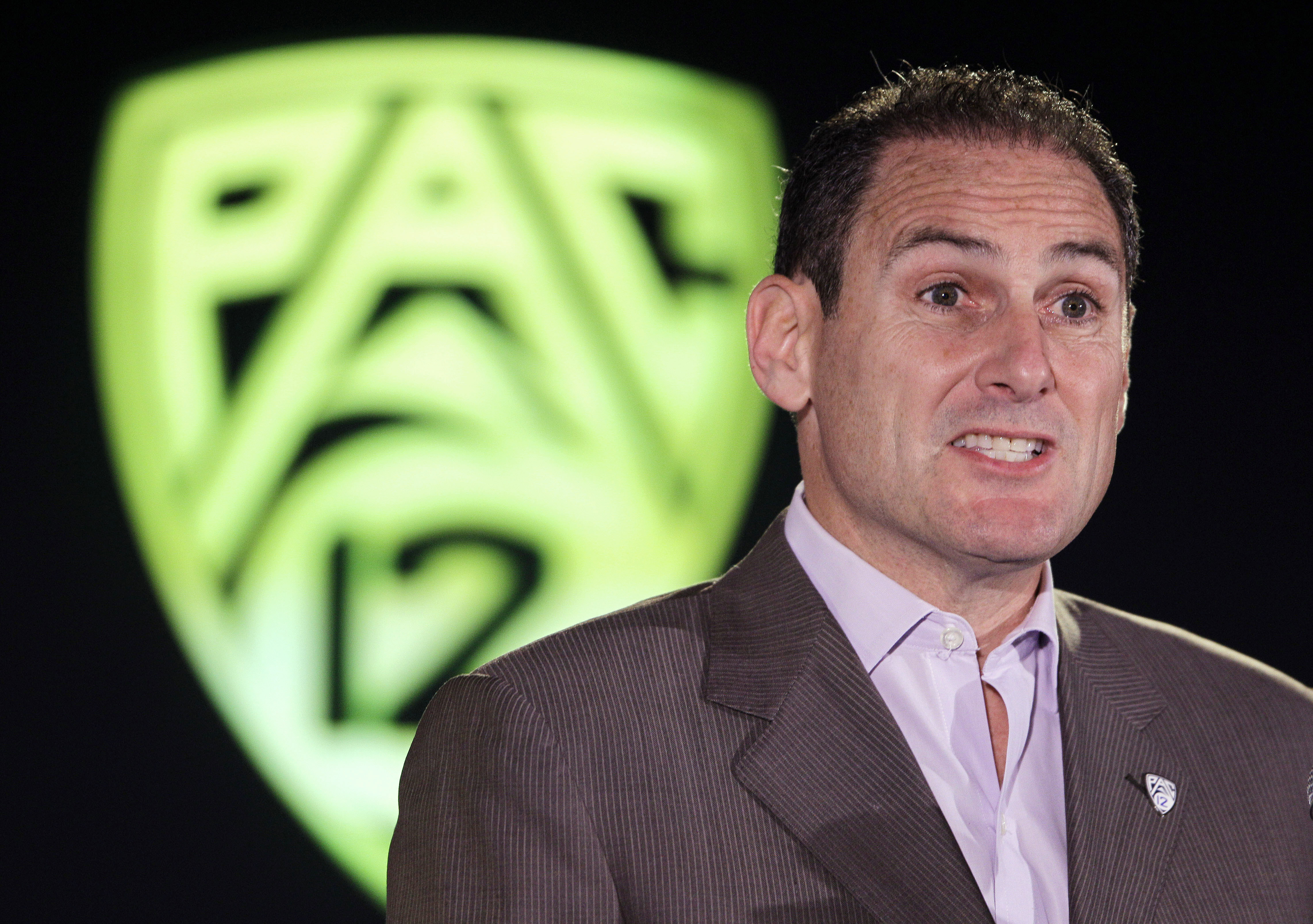 """FILE - In this Nov. 1, 2012, file photo, Pac-12 Commissioner Larry Scott speaks during the PAC-12 college basketball media day in San Francisco. Scott says the kind of NCAA reform sought by the most powerful conferences is not an """"us vs. them situation."""""""