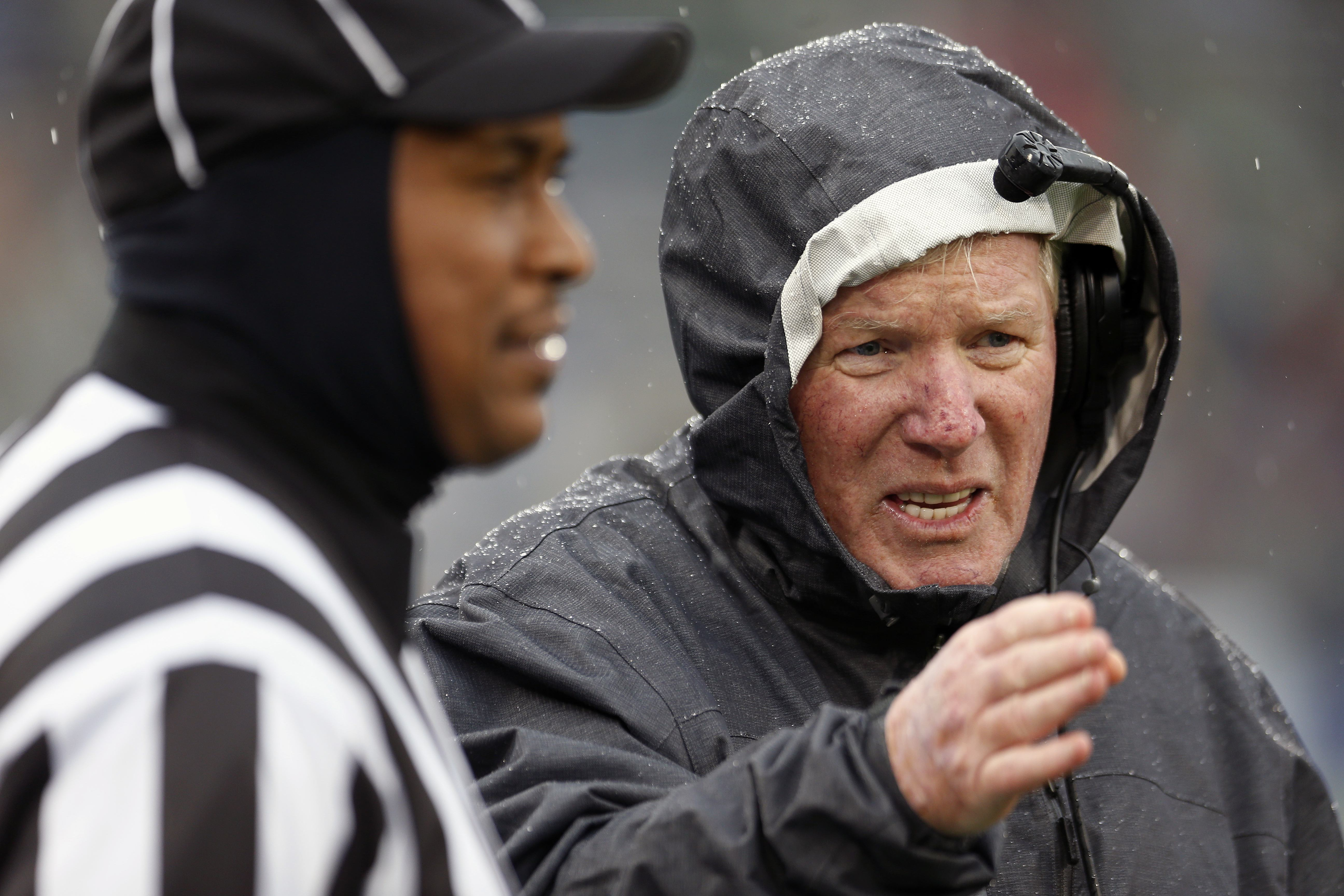 FILE - In this Nov. 1, 2014 file photo, Central Florida head coach George O'Leary, right, talks with an official in the first quarter of an NCAA college football game against Connecticut in East Hartford, Conn. UConn's football coach is looking forward to
