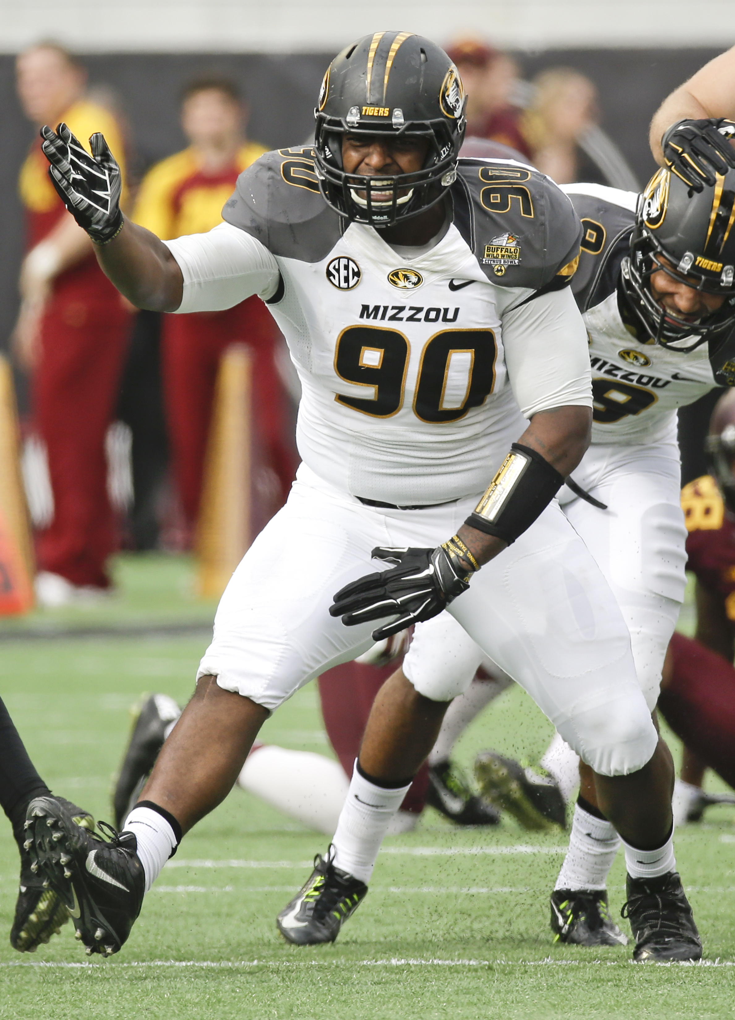 Missouri defensive lineman Harold Brantley (90) signals a first down after he ran for a first down past the Minnesota defensive on a fake punt play during the first half of the Citrus Bowl NCAA college football game in Orlando, Fla., Thursday, Jan. 1, 201