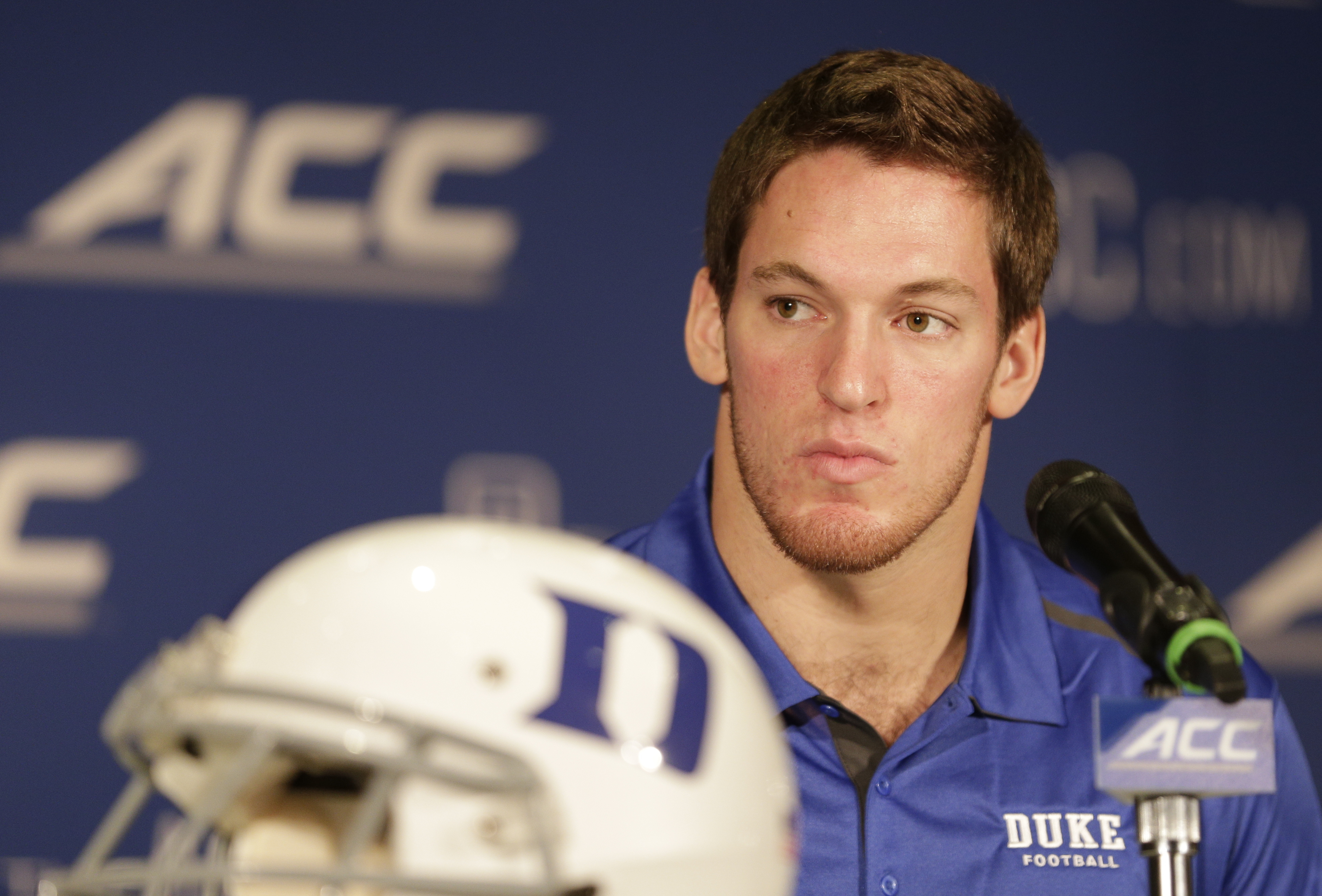 Duke's Kelby Brown answers a question during a news conference at the Atlantic Coast Conference Football kickoff in Greensboro, N.C., Sunday, July 20, 2014. (AP Photo/Chuck Burton)