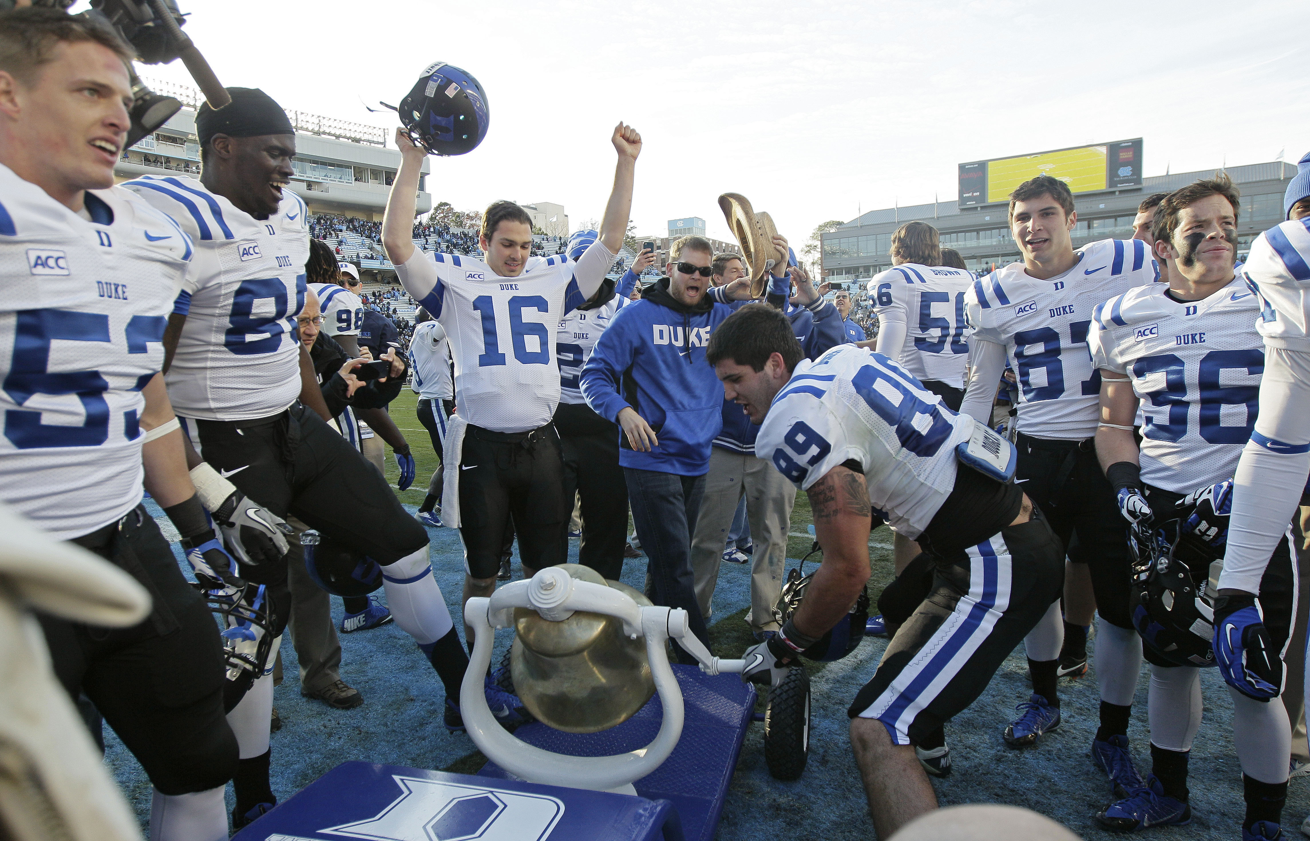 FILE - In this Nov. 30, 2013, file photo,  Duke's Braxton Deaver (89) rings the victory bell with teammates following Duke's 27-25 win over North Carolina in an NCAA college football game in Chapel Hill, N.C. Deaver, a 23-year-old, sixth-year tight end at