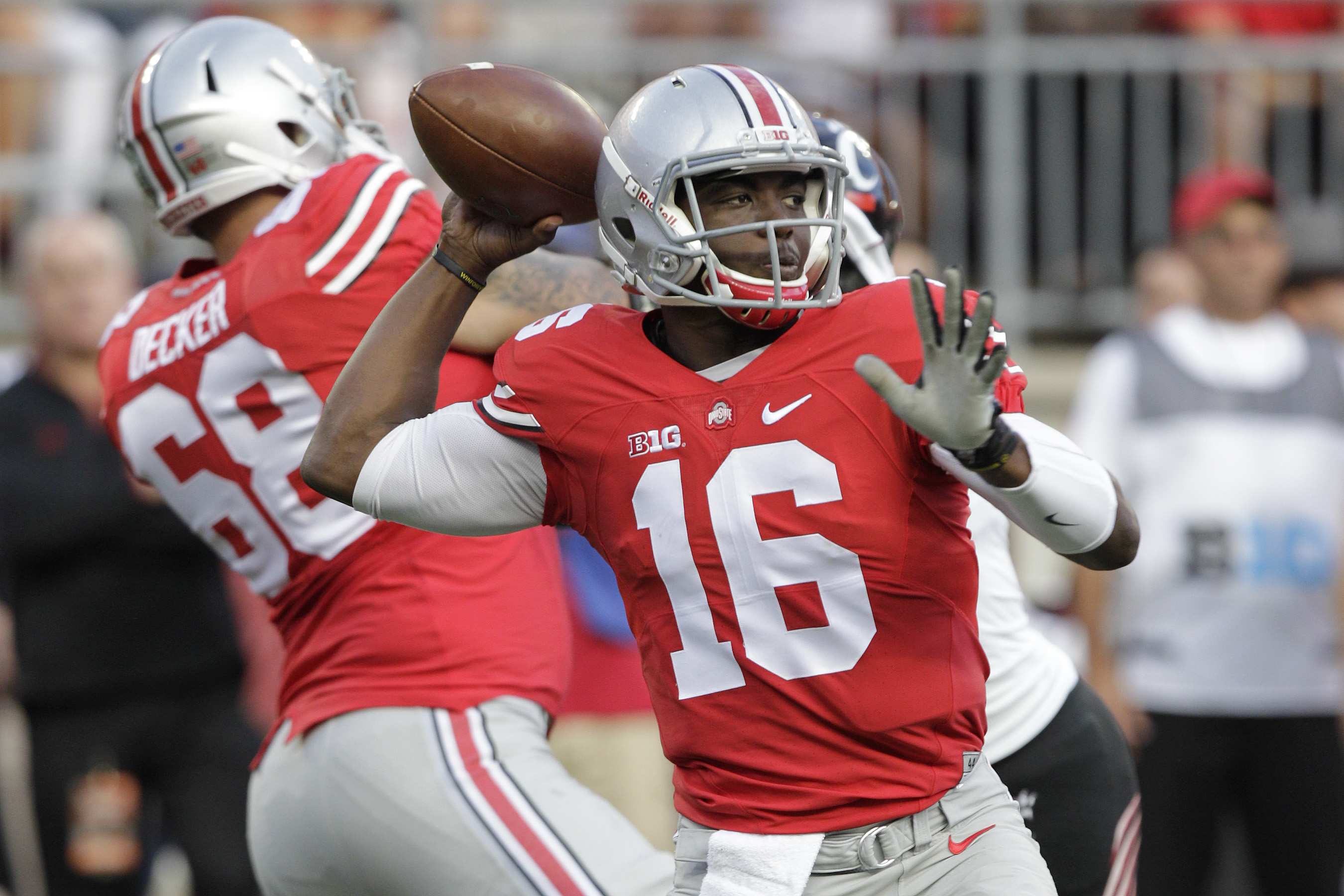 FILE - In this Sept. 27, 2014, file photo, Ohio State quarterback J.T. Barrett plays against Cincinnati during an NCAA college football game in Columbus, Ohio. Many were surprised when redshirt freshman Barrett was ordained in the preseason as the backup