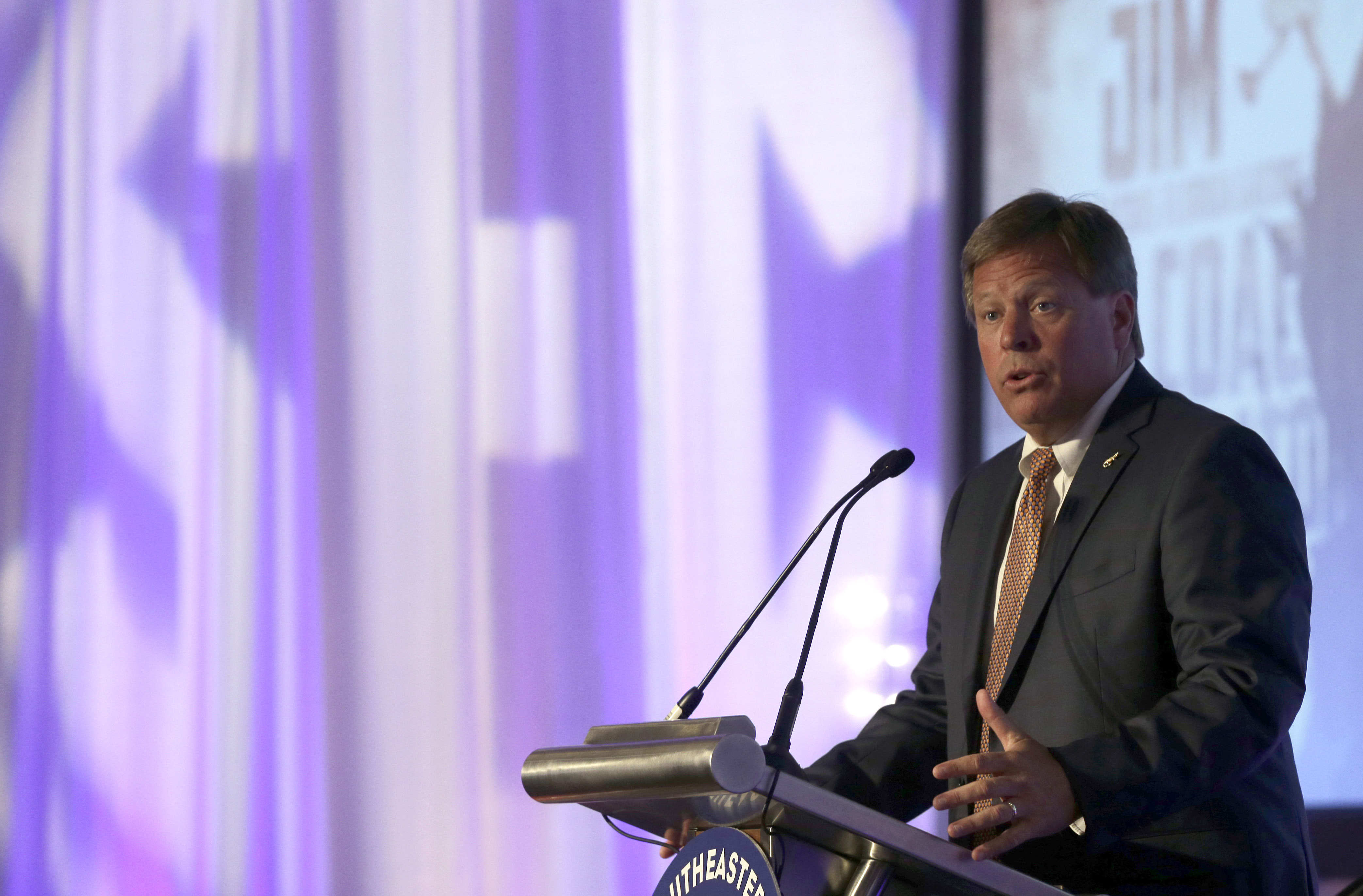 Florida coach Jim McElwain speaks to the media during the NCAA college football Southeastern Conference Media Days, Monday, July 13, 2015, in Hoover, Ala. (AP Photo/Butch Dill)