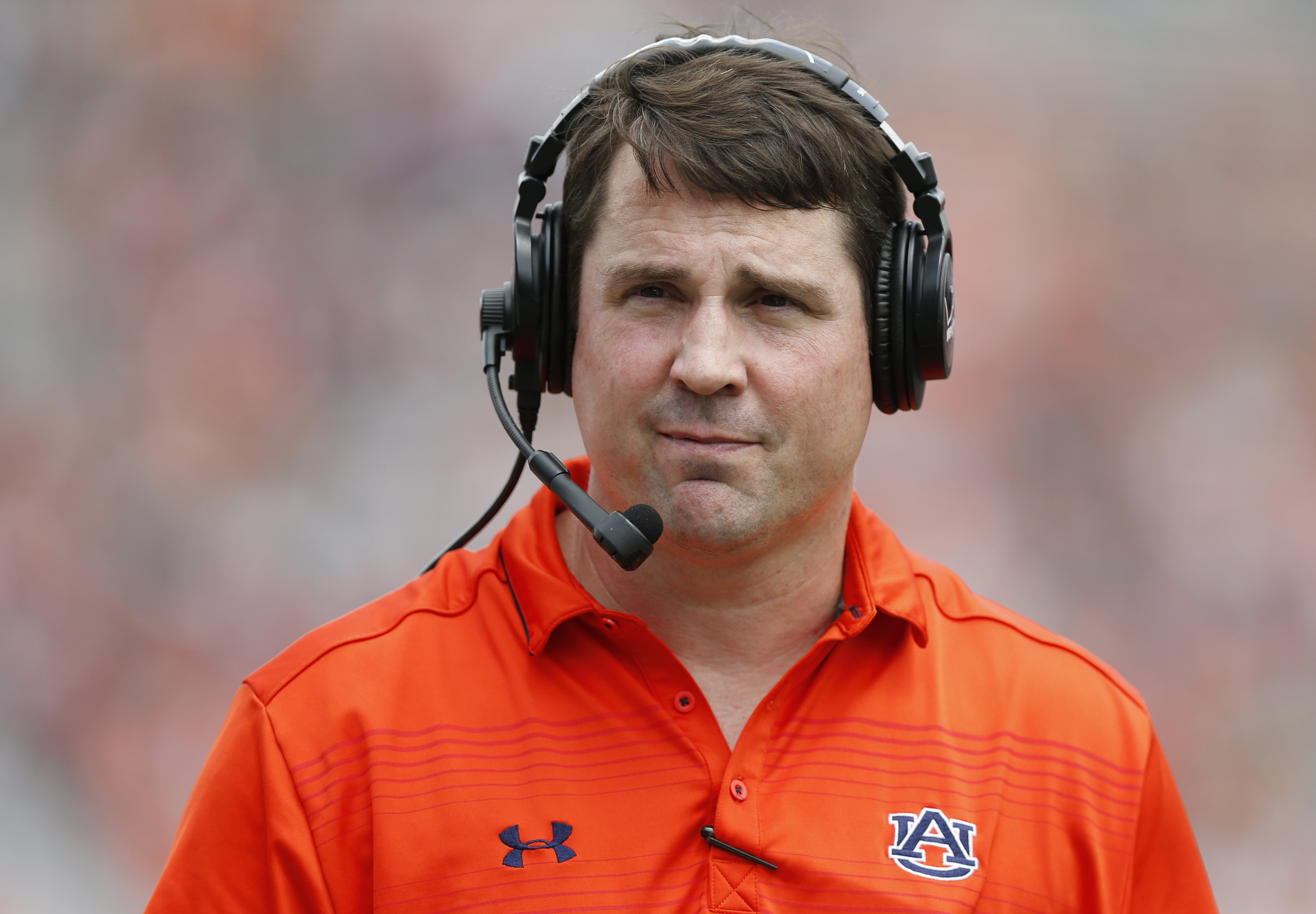 Auburn defensive coordinator Will Muschamp walks around the football field in the first quarter during their spring NCAA college football game, Saturday, April 18, 2015, in Auburn, Ala. (AP Photo/Brynn Anderson)