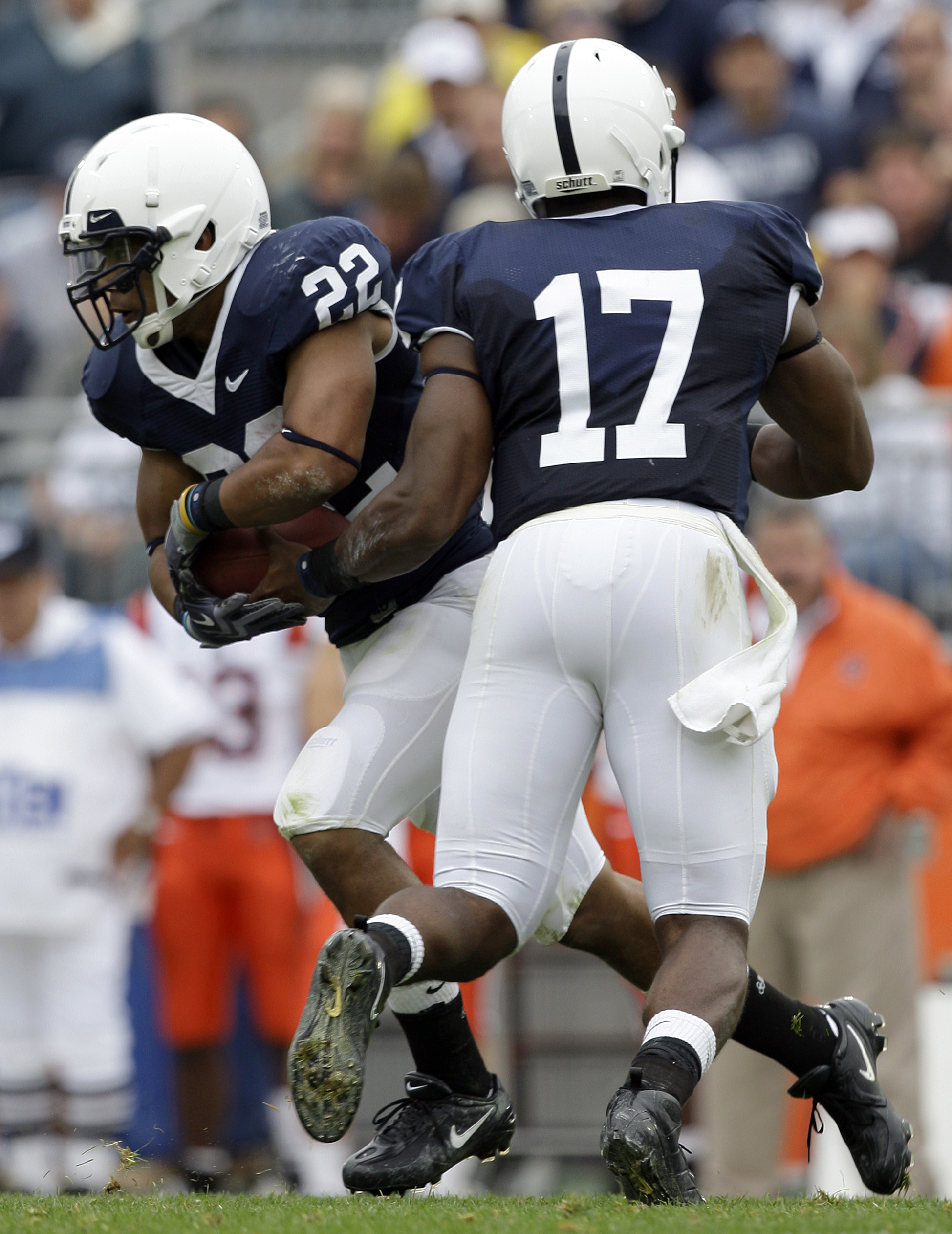 In this Saturday, Sept. 12, 2009, photo, Penn State quarterback Daryll Clark hands off to running back Evan Royster in the first half of their college football game against Syracuse in State College, Pa. Penn State won 28-7.  (AP Photo/Carolyn Kaster)
