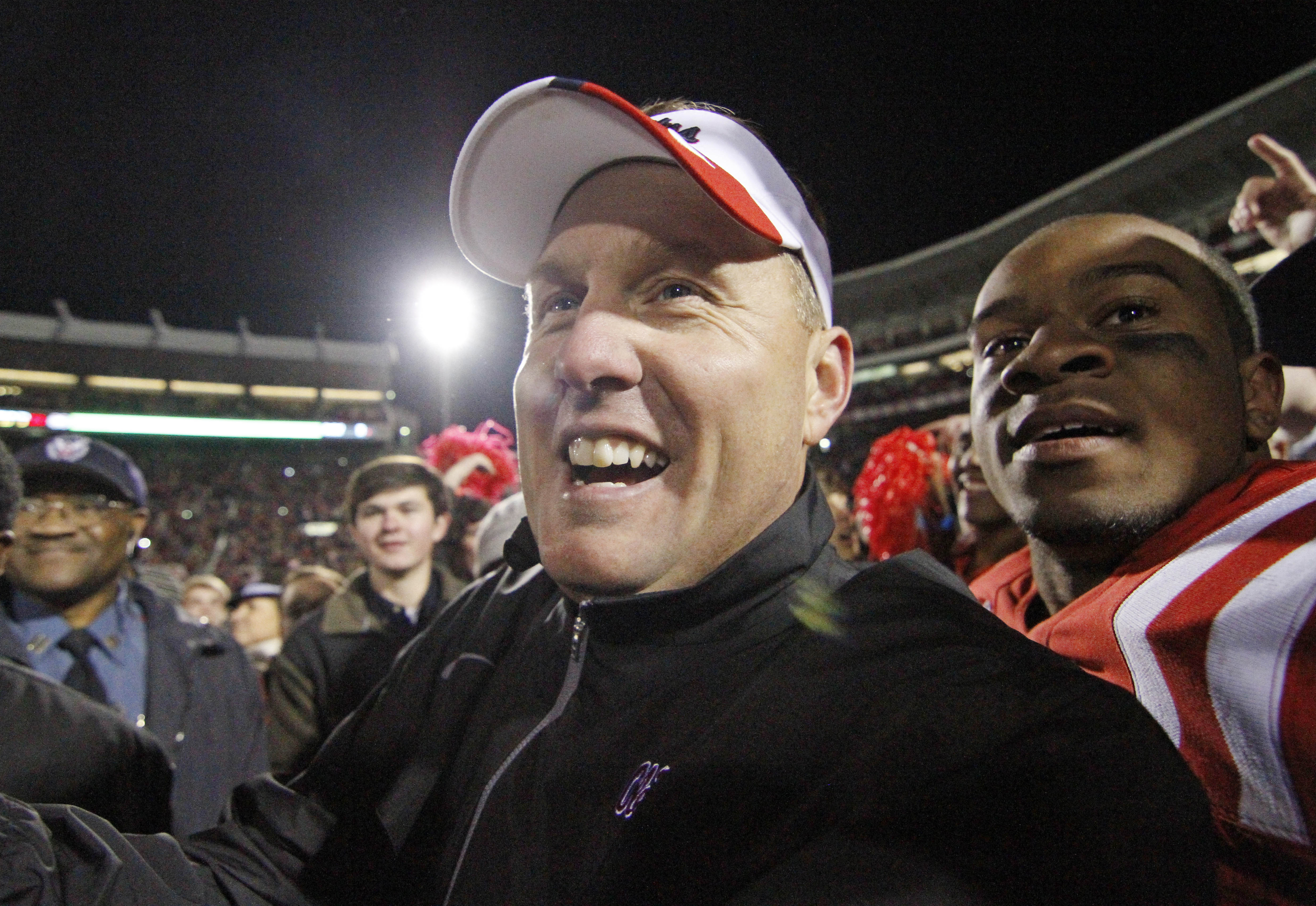 Mississippi coach Hugh Freeze and linebacker Denzel Nkemdiche, right, celebrate after the team's 41-24 win over No. 25 Mississippi State in an NCAA college football game in Oxford, Miss., Saturday, Nov. 24, 2012.  (AP Photo/Rogelio V. Solis)