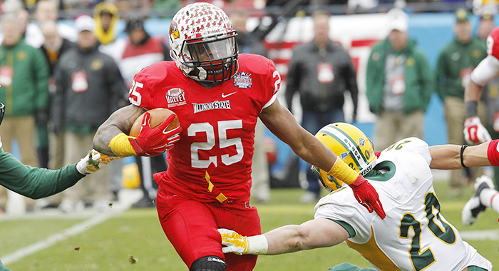 Illinois State running back Marshaun Coprich (25) carries the ball as North Dakota State safety Colten Heagle (20) tries to tackle during the FCS Championship NCAA college football game Saturday, Jan. 10, 2015, in Frisco, Texas.   North Dakota State won t