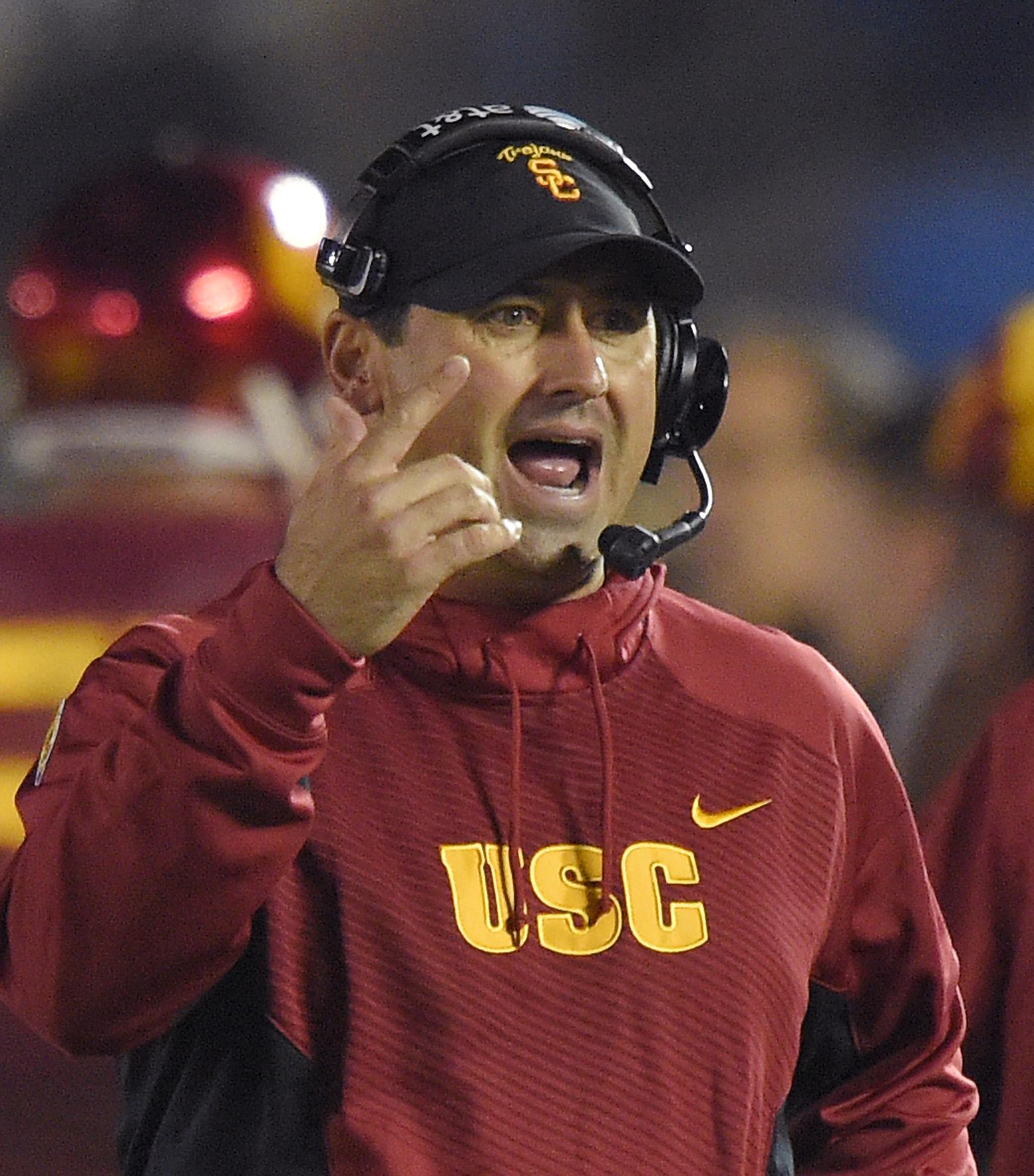 Southern California head coach Steve Sarkisian gestures during the first half of an NCAA college football game against UCLA, Saturday, Nov. 22, 2014, in Pasadena, Calif. (AP Photo/Mark J. Terrill)
