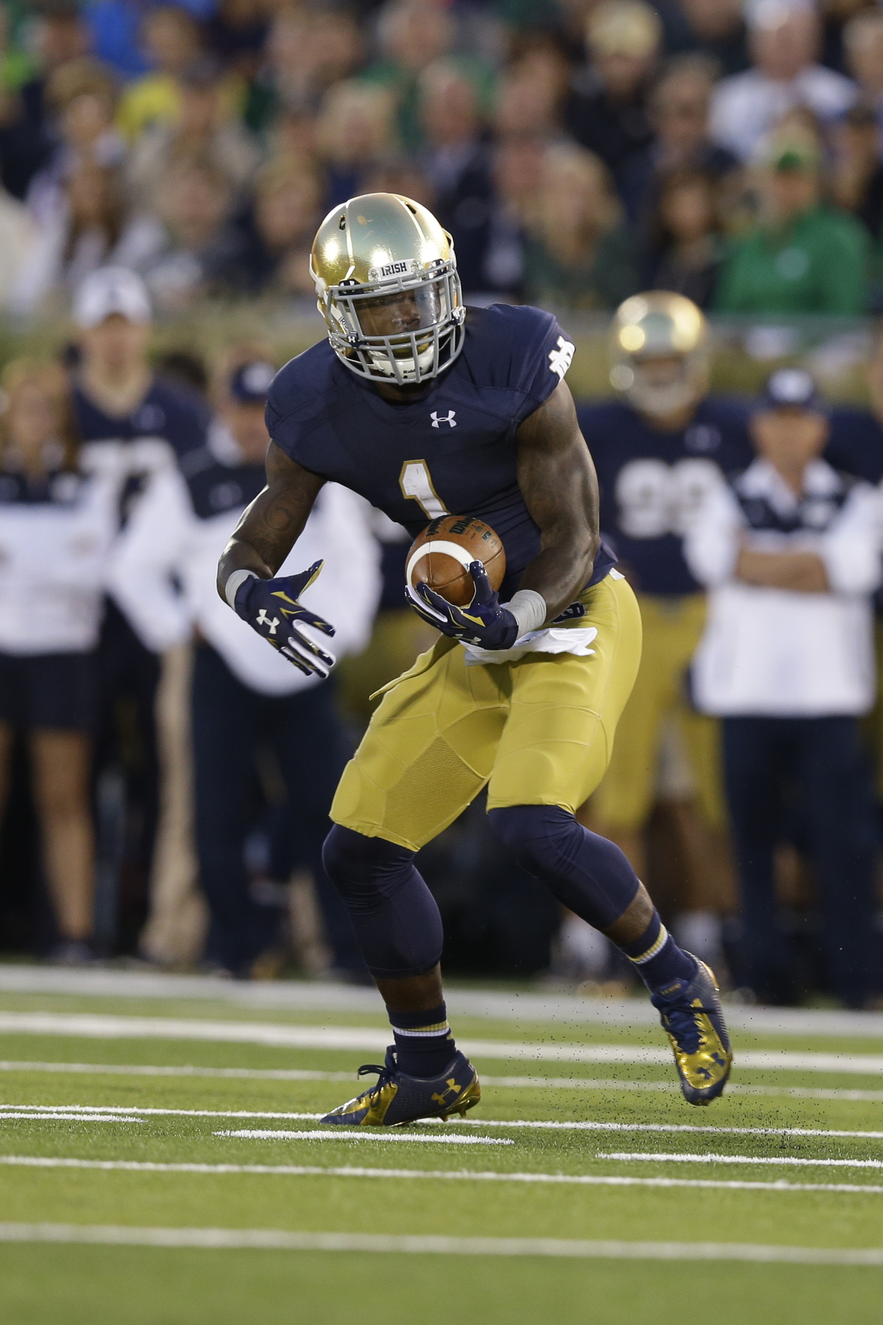 Notre Dame running back Greg Bryant during the first half of an NCAA college football game against Michigan in South Bend, Ind., Saturday, Sept. 6, 2014. (AP Photo/Michael Conroy)