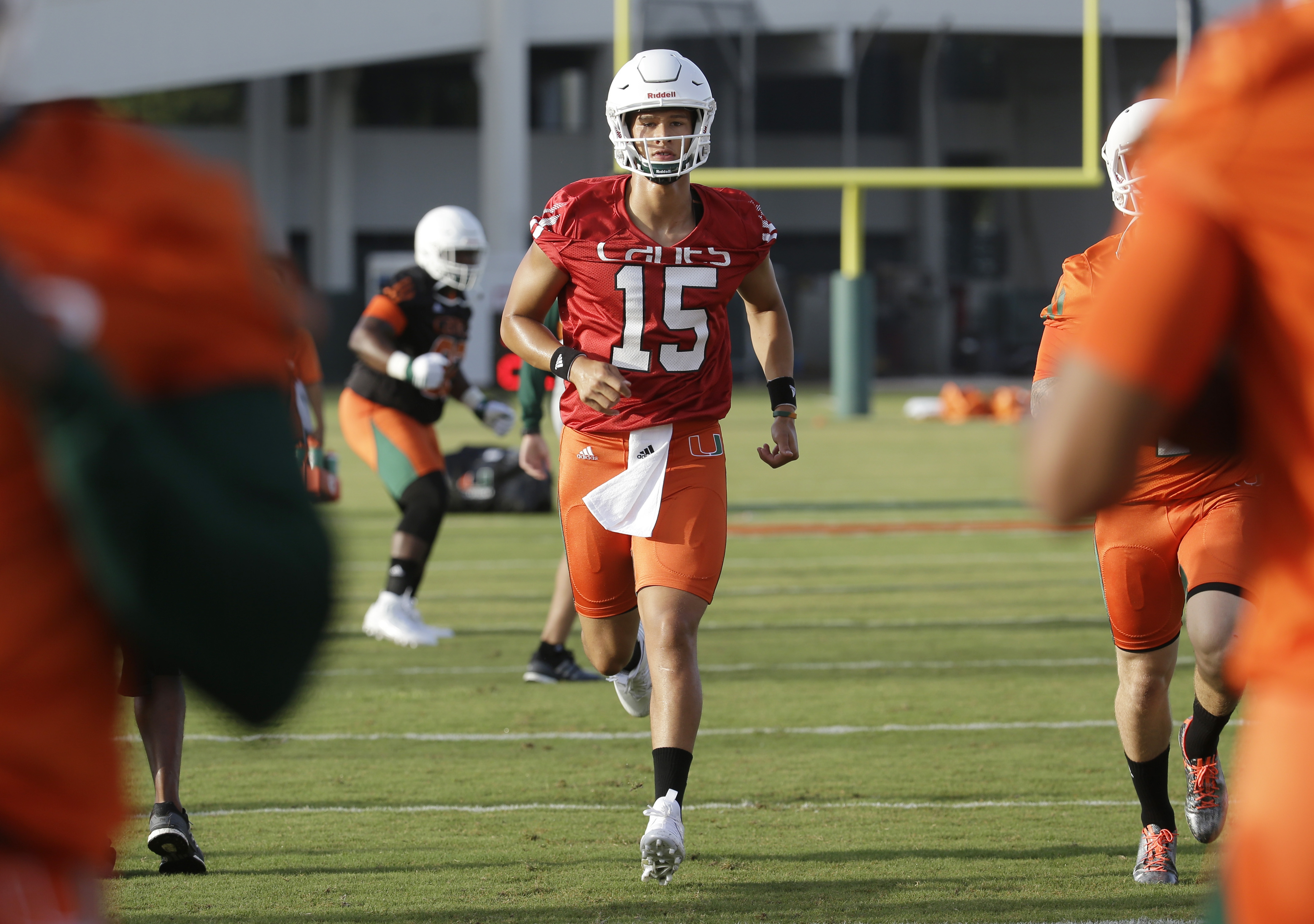 Miami quarterback Brad Kaaya (15) runs drills during NCAA college football practice, Thursday, Aug. 6, 2015,  in Coral Gables, Fla. The latest effort toward rebuilding, reshaping and rebranding the Hurricanes started more than seven months ago and the nex