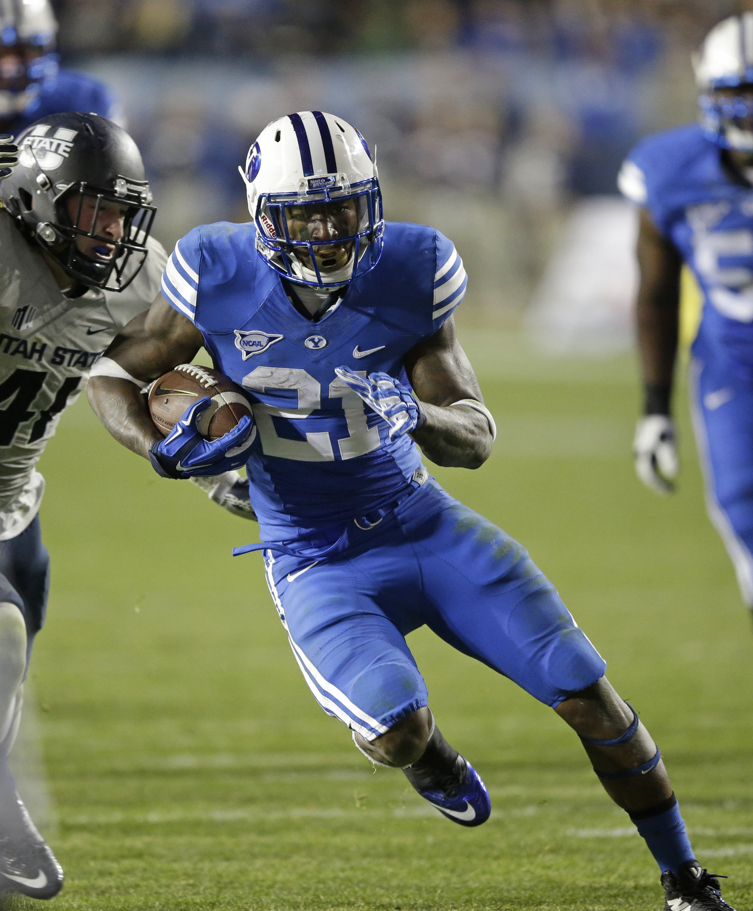 Brigham Young running back Jamaal Williams (21) carries the ball in the second half during an NCAA college football game against Utah State Friday, Oct. 3, 2014, in Provo, Utah. (AP Photo/Rick Bowmer)
