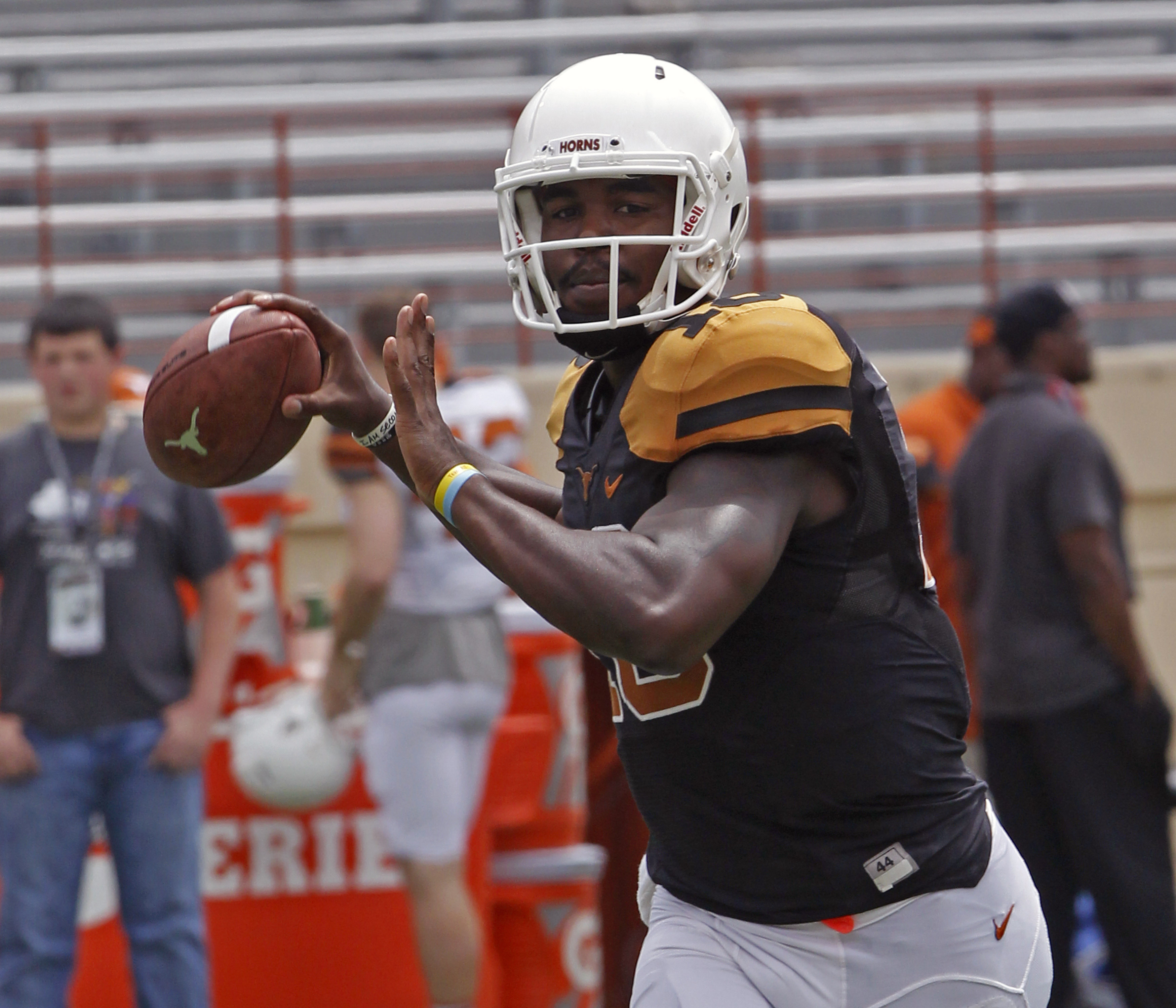 Texas quarterback Tyrone Swoopes warms up before the start of Texas' Orange and White spring NCAA college football game, Saturday, April 18, 2015, in Austin, Texas. (AP Photo/Michael Thomas)