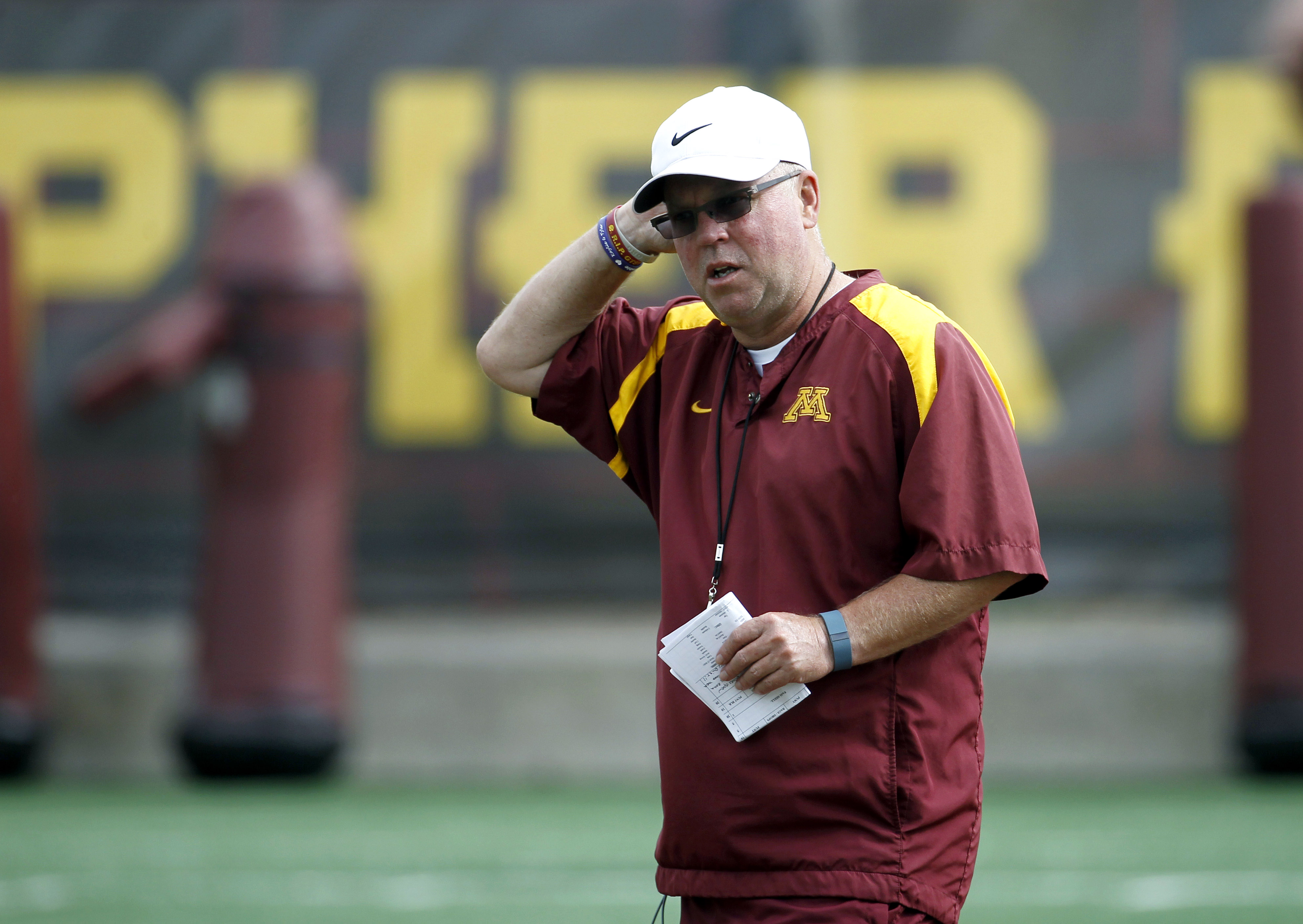 Minnesota head coach Jerry Kill watches his players during NCAA college football training camp in Minneapolis Friday, Aug. 7, 2015. (AP Photo/Ann Heisenfelt)