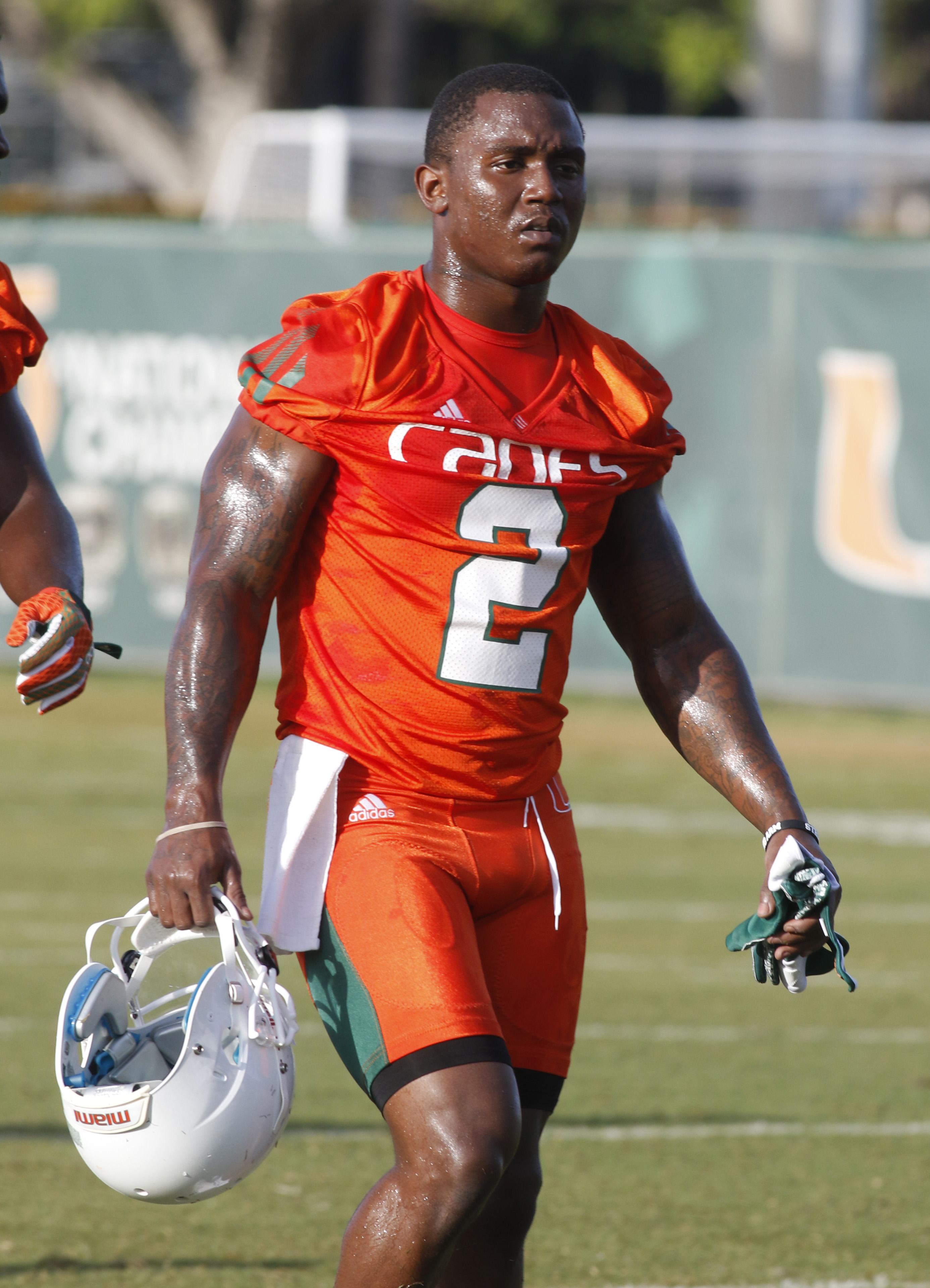 Miami running back Joseph Yearby walks on the field during the team's NCAA college football practice, Friday, Aug. 7, 2015, in Coral Gables, Fla. The team is not bothered by a national perception that they will struggle this season. (AP Photo/Joe Skipper)
