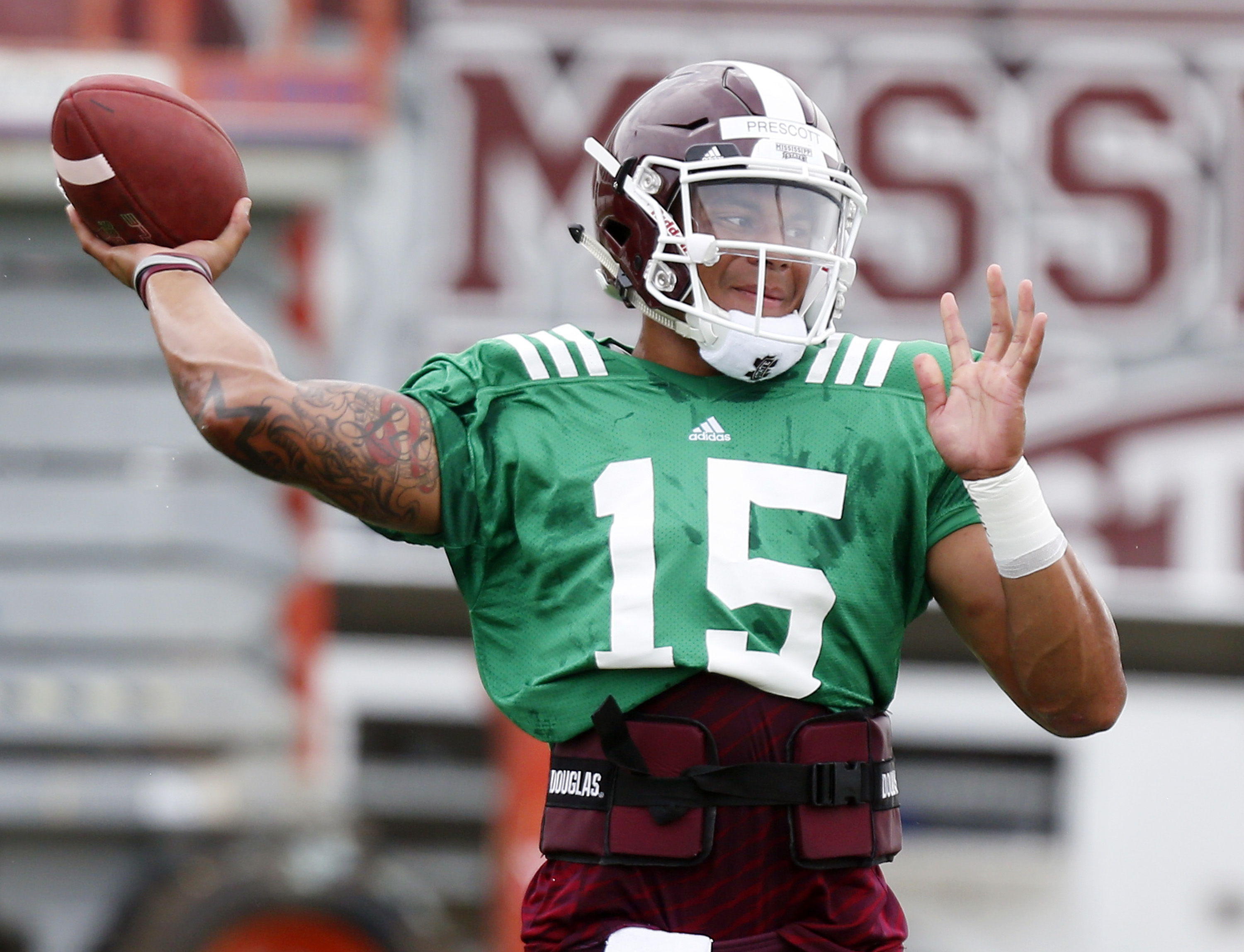 Mississippi State quarterback Dak Prescott passes during drills at NCAA college football practice in Starkville, Miss., Friday, Aug. 7, 2015. (AP Photo/Rogelio V. Solis)