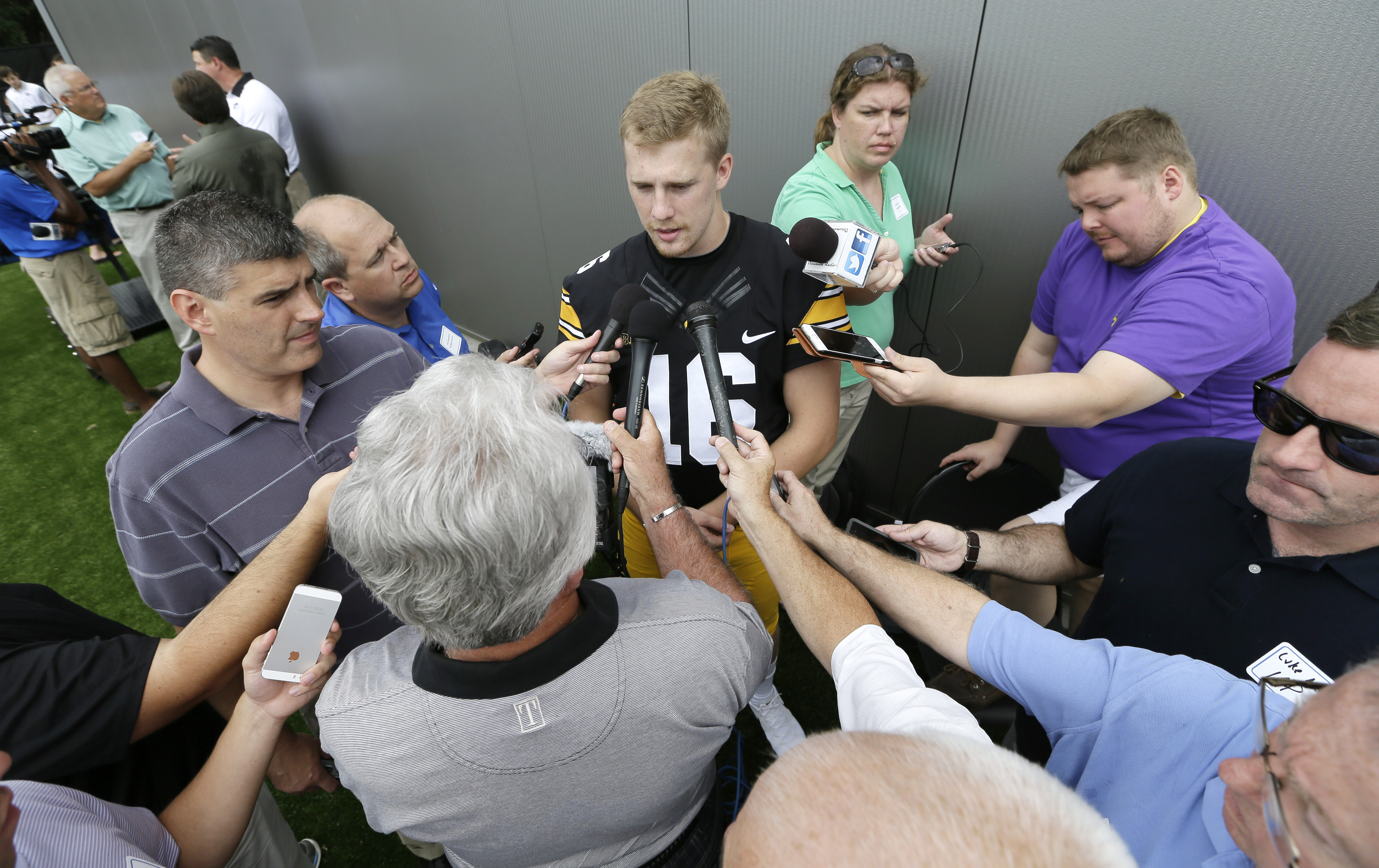 Iowa quarterback C.J. Beathard, center, speaks to reporters during the annual NCAA college football media day, Saturday, Aug. 8, 2015, in Iowa City, Iowa. (AP Photo/Charlie Neibergall)