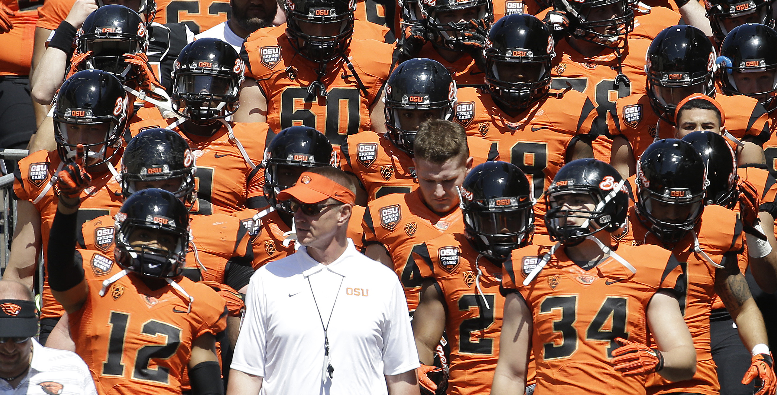 FILE - In this April 18, 2015, file photo, Oregon State coach Gary Anderson walks onto the field with the orange squad before their NCAA college football spring game in Corvallis, Ore. The Pac-12's only new coach this fall realized he was rejoining a leag