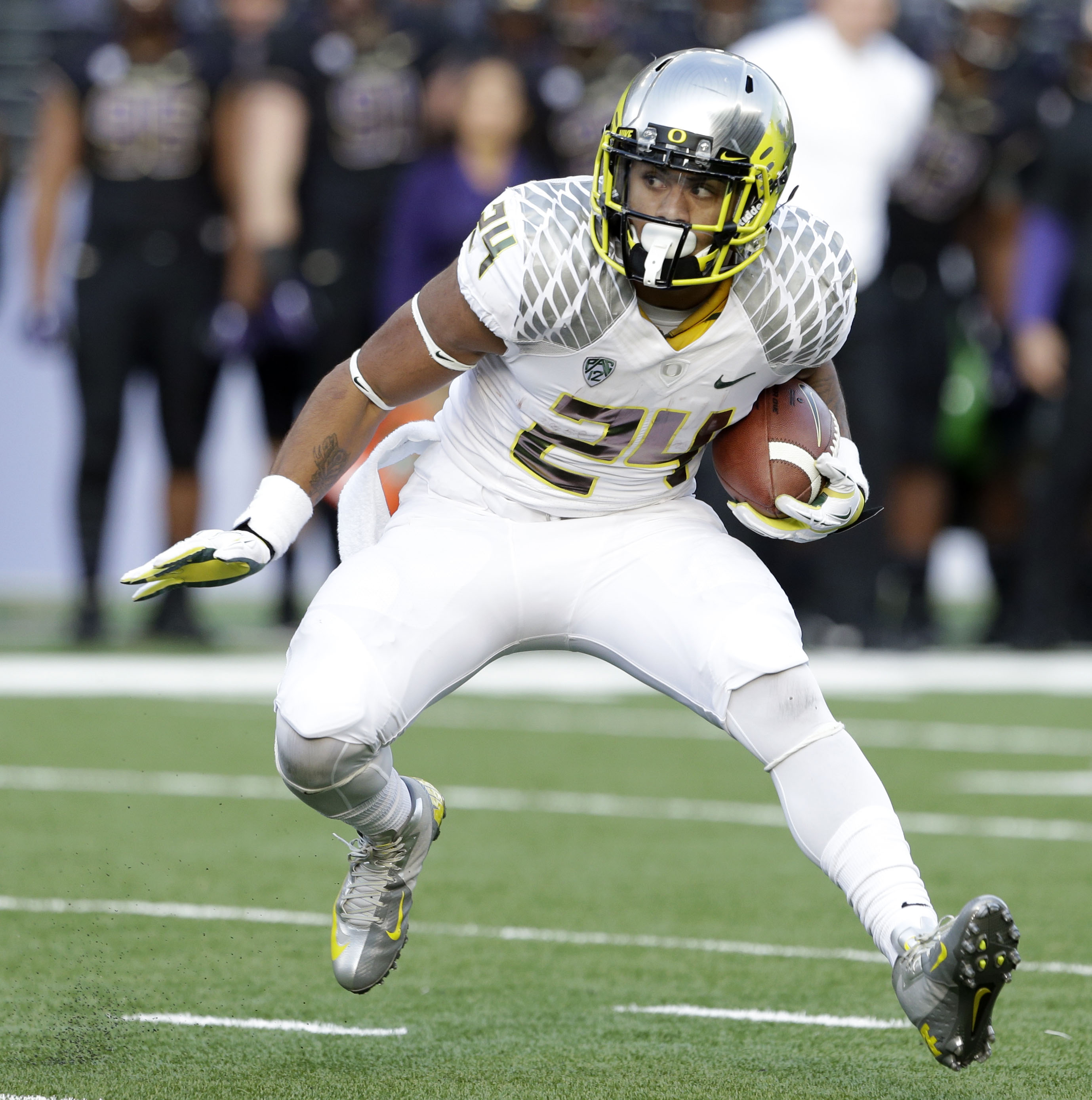 File- This Oct. 12, 2013, file photo shows Oregon's Thomas Tyner in action against Washington in the second half of an NCAA college football game in Seattle. Tyner is out for fall camp and he could miss the season after shoulder surgery. Coach Mark Helfri