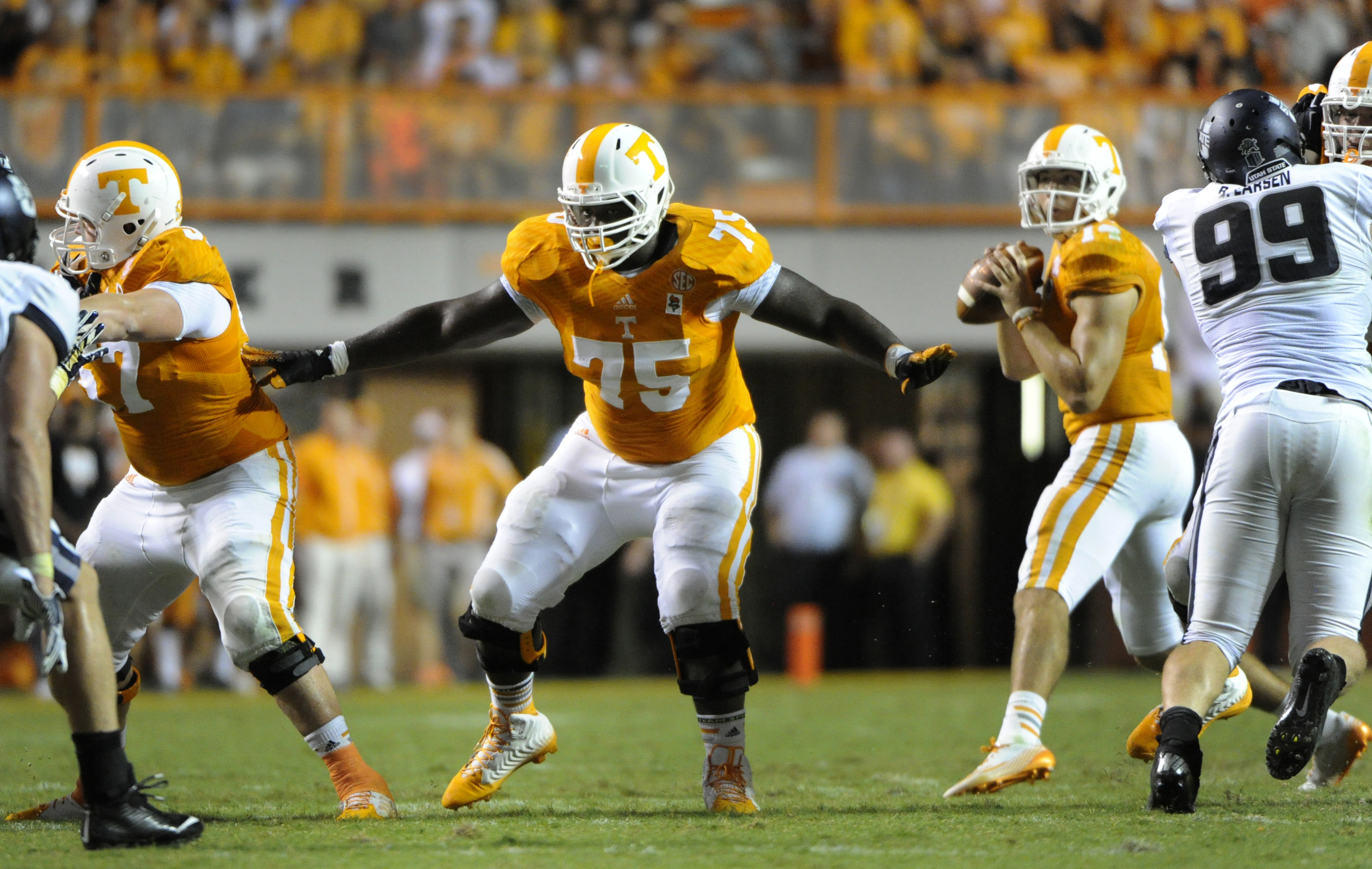 In this Aug. 31, 2014, photo, Tennessee offensive lineman Marcus Jackson (75) provides pass protection during a NCAA football game against Utah State in Knoxville, Tenn. Jackson will undergo potential season-ending surgery, leaving the Volunteers without