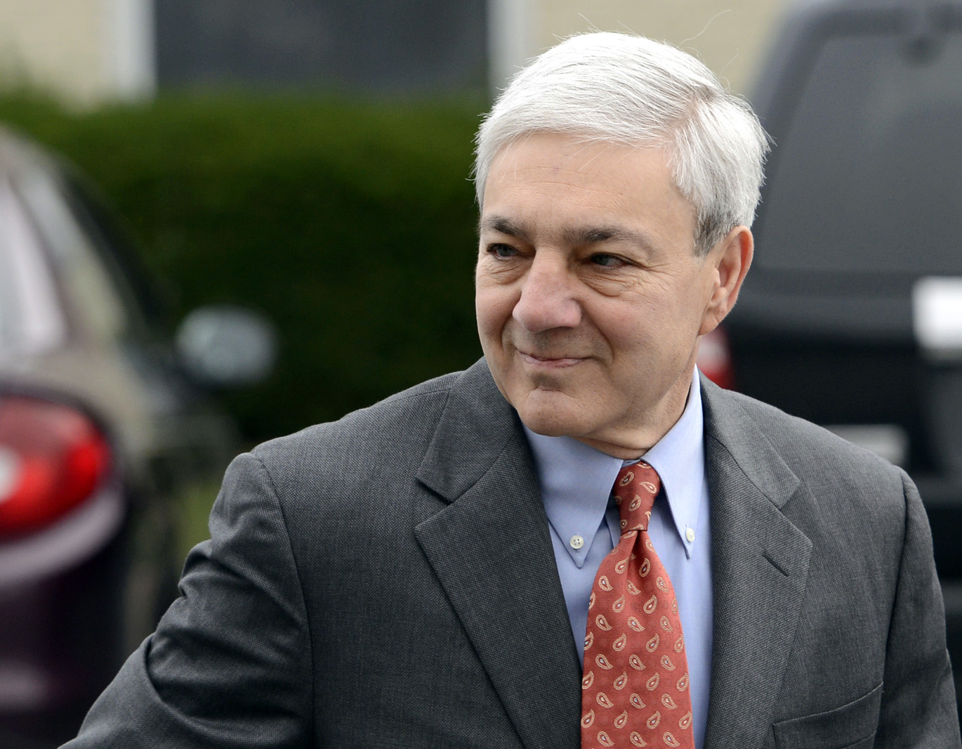 FILE - In this Nov. 7, 2012, file photo, former Penn State president Graham Spanier enters Harrisburg District court in Harrisburg, Pa., to be arraigned on charges he lied about and concealed child sex abuse allegations involving former assistant football