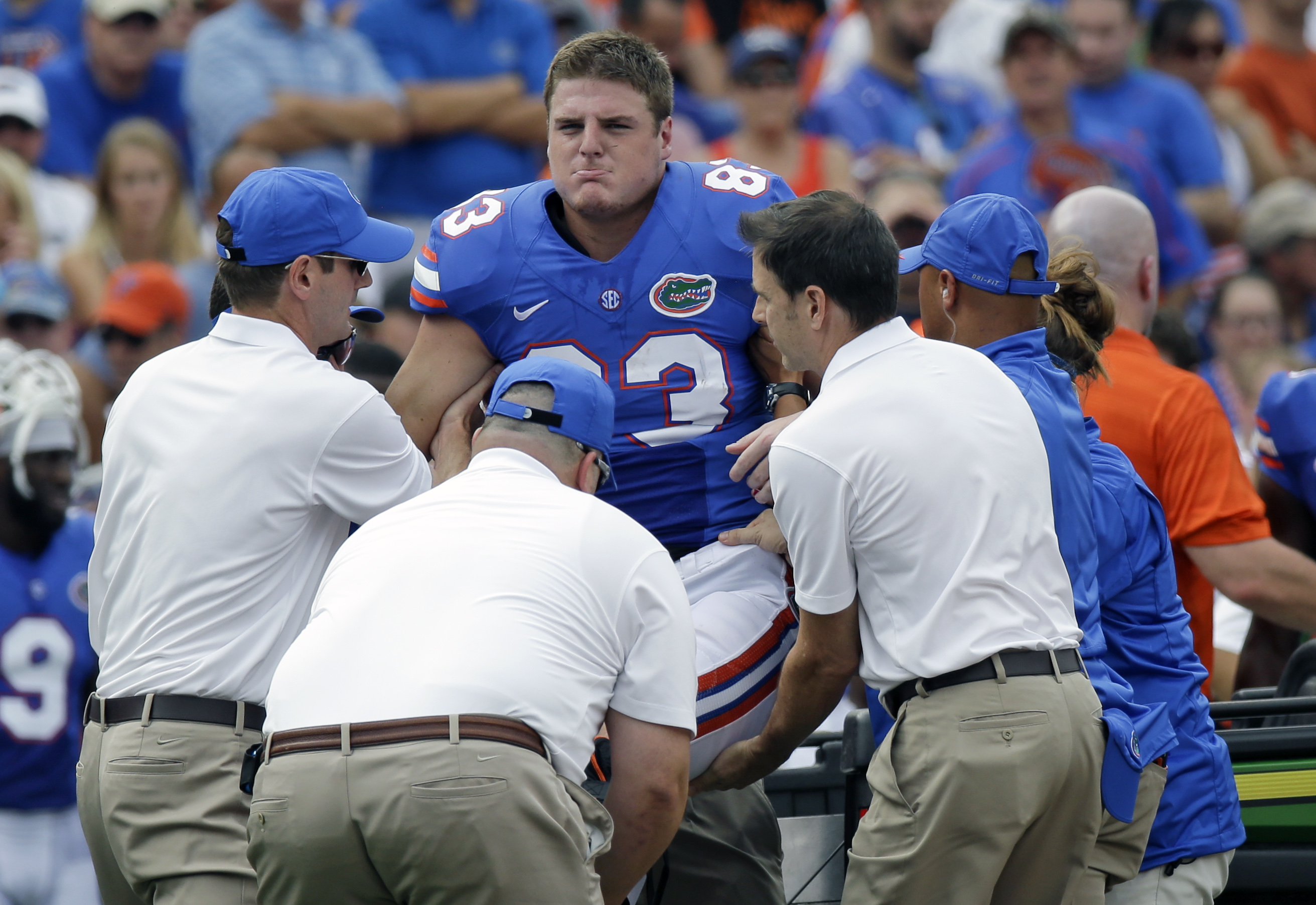 FILE - In this Sept. 6, 2014, file photo, team personnel lift Florida tight end Jake McGee on a cart to take him off the field after was injured during the first half of an NCAA college football game against Eastern Michigan in Gainesville, Fla. McGee bro