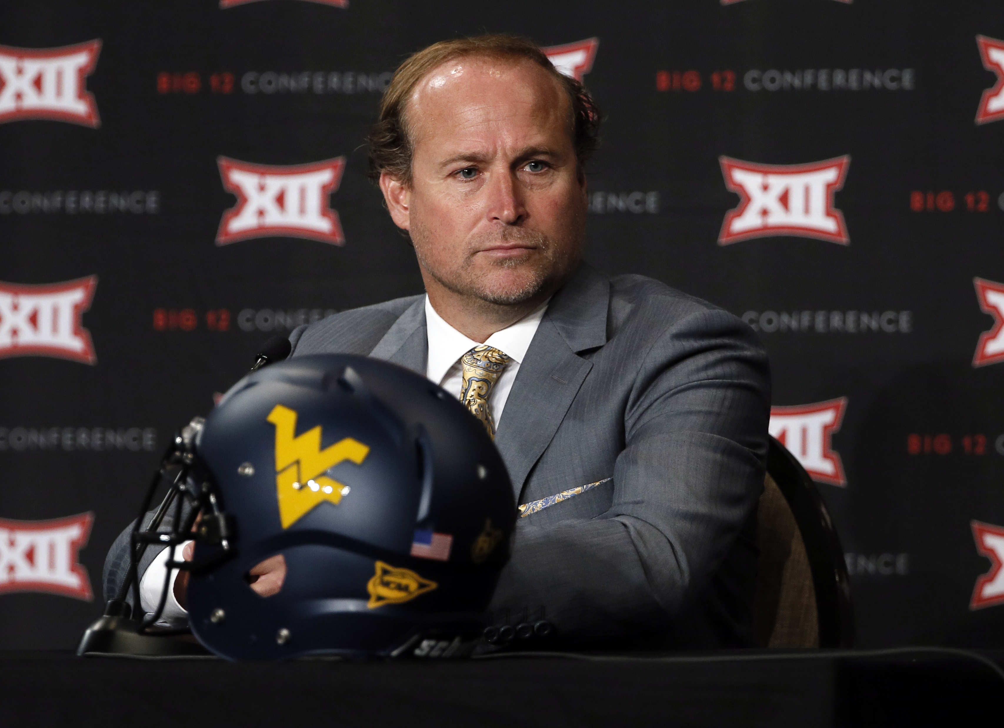 FILE - In this July 20, 2015, file photo, West Virginia head football coach Dana Holgorsen addresses attendees at Big 12 Conference Football Media Days in Dallas. The bar may not be set too high for West Virginia, which is predicted to finish toward the b