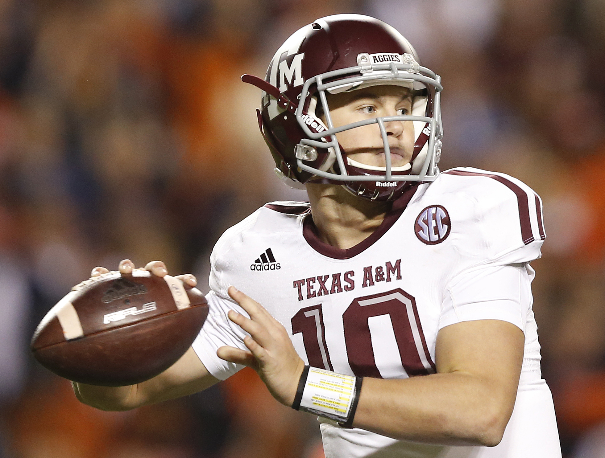 FILE - In this Nov. 8, 2014, file photo, Texas A&M quarterback Kyle Allen (10) sets back to throw the ball against Auburn during the second half of an NCAA college football game in Auburn, Ala. Kyle Allen showed enough promise as a freshman last year to e