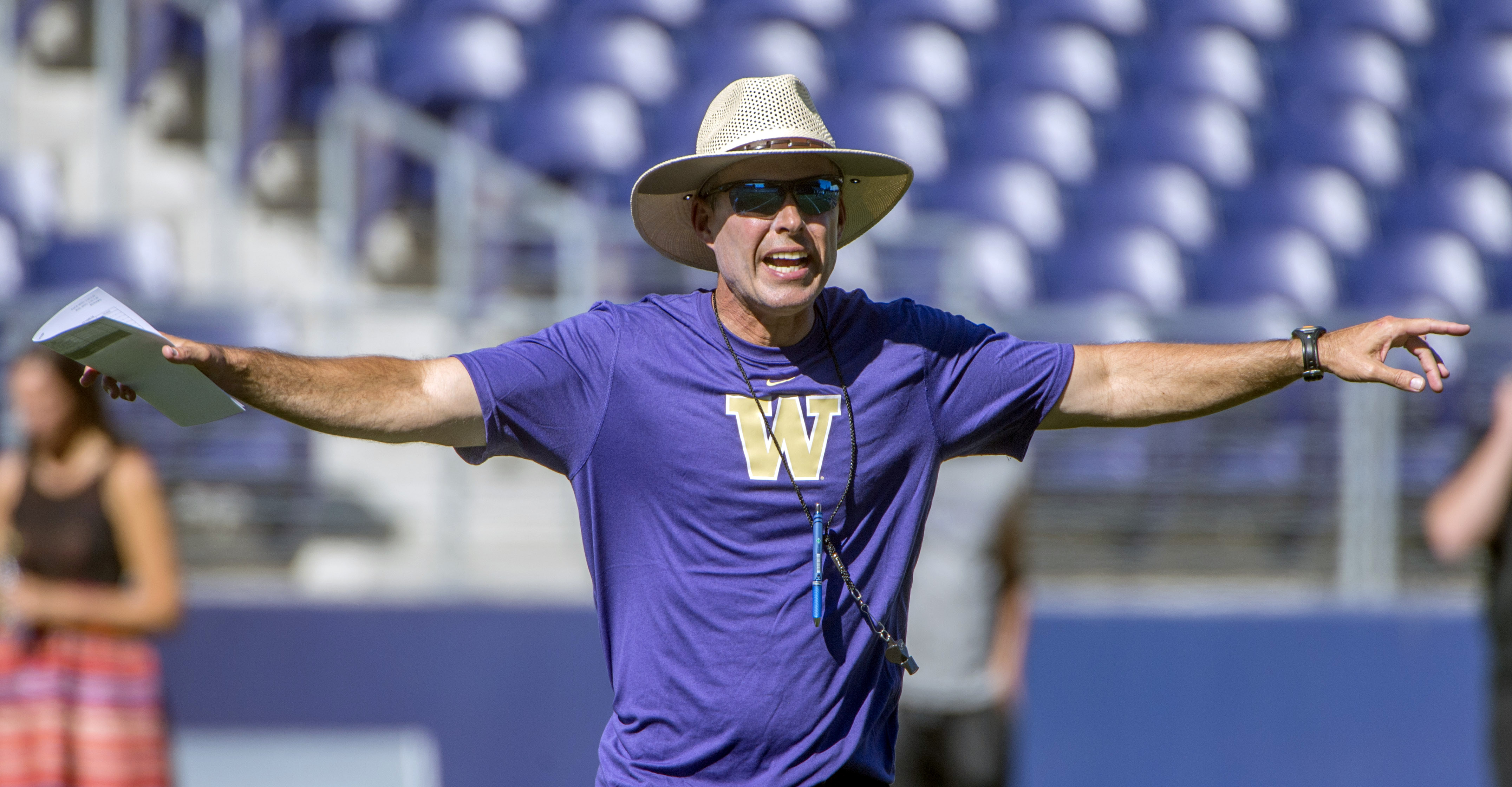 FILE - In this Aug. 4, 2014, file photo, Washington NCAA college football coach Chris Petersen gestures during practice at Husky Stadium in Seattle. Significant talent departures, a lack of upperclassmen, a challenging schedule and questions at the most i