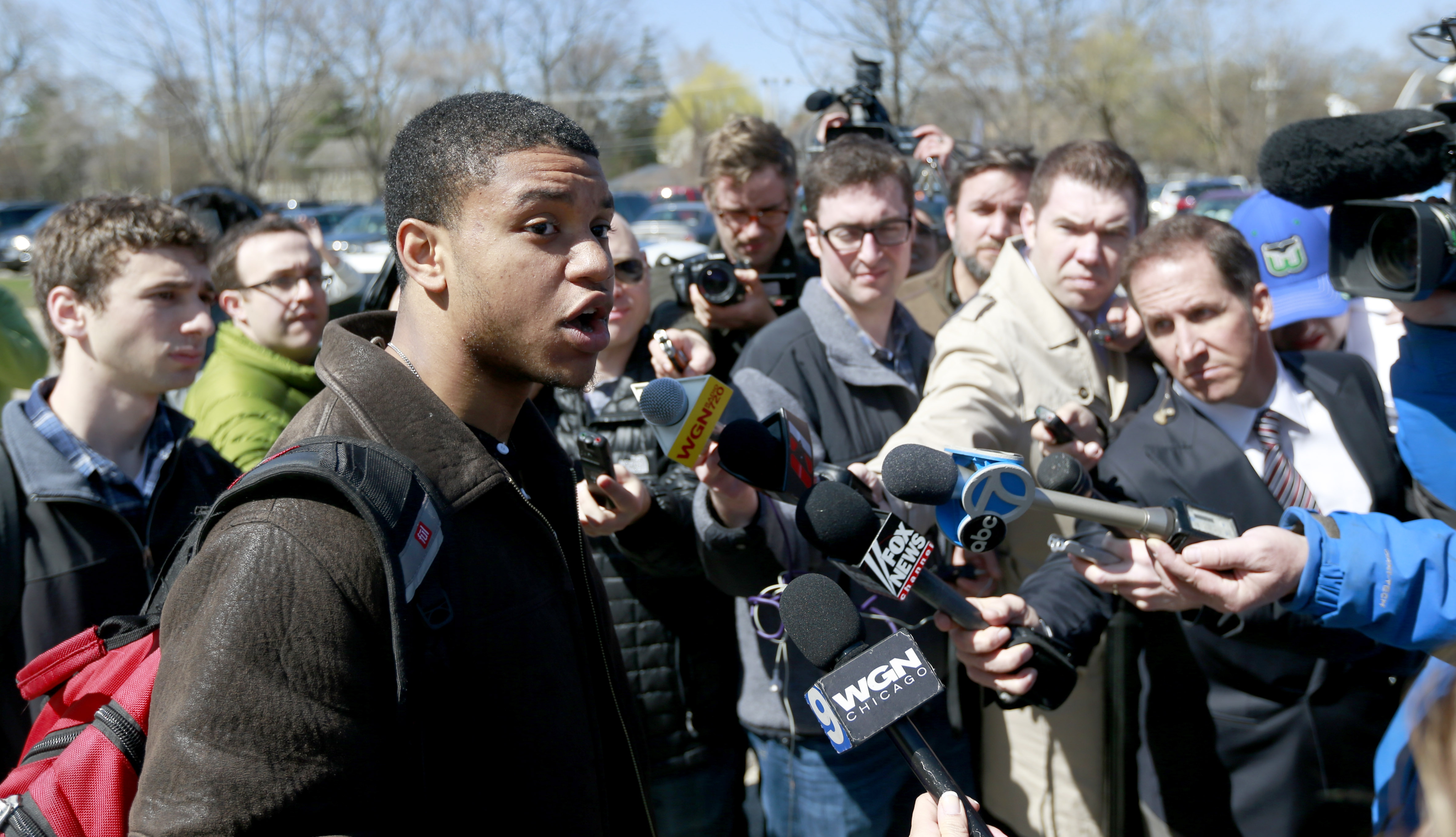 FILE - In this April 25, 2014, file photo, former Northwestern University football player Michael Odom talks to reporters as his former teammates vote on the student athlete union question in Evanston, Ill. The National Labor Relations Board has dismissed
